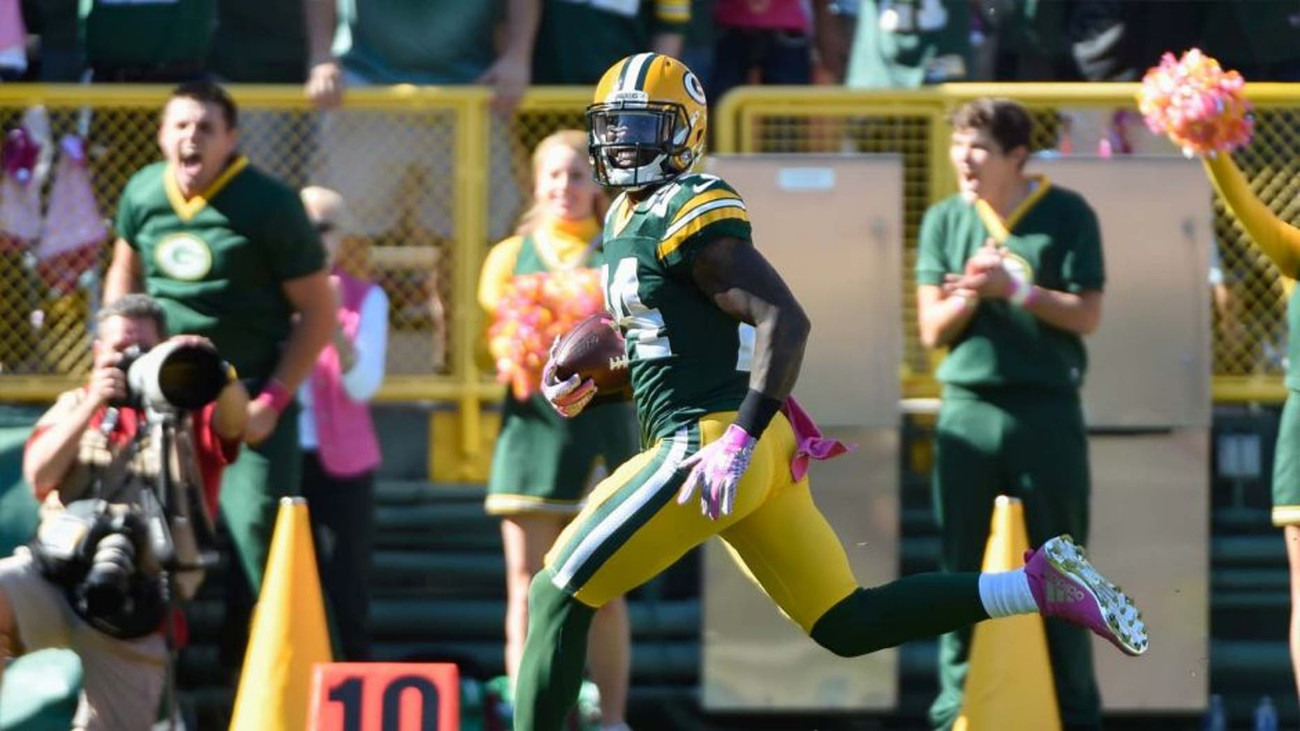Sunday, Oct. 11: Green Bay Packers cornerback Quinten Rollins returns an interception for a touchdown in the first quarter against the St. Louis Rams at Lambeau Field in Green Bay, Wis.