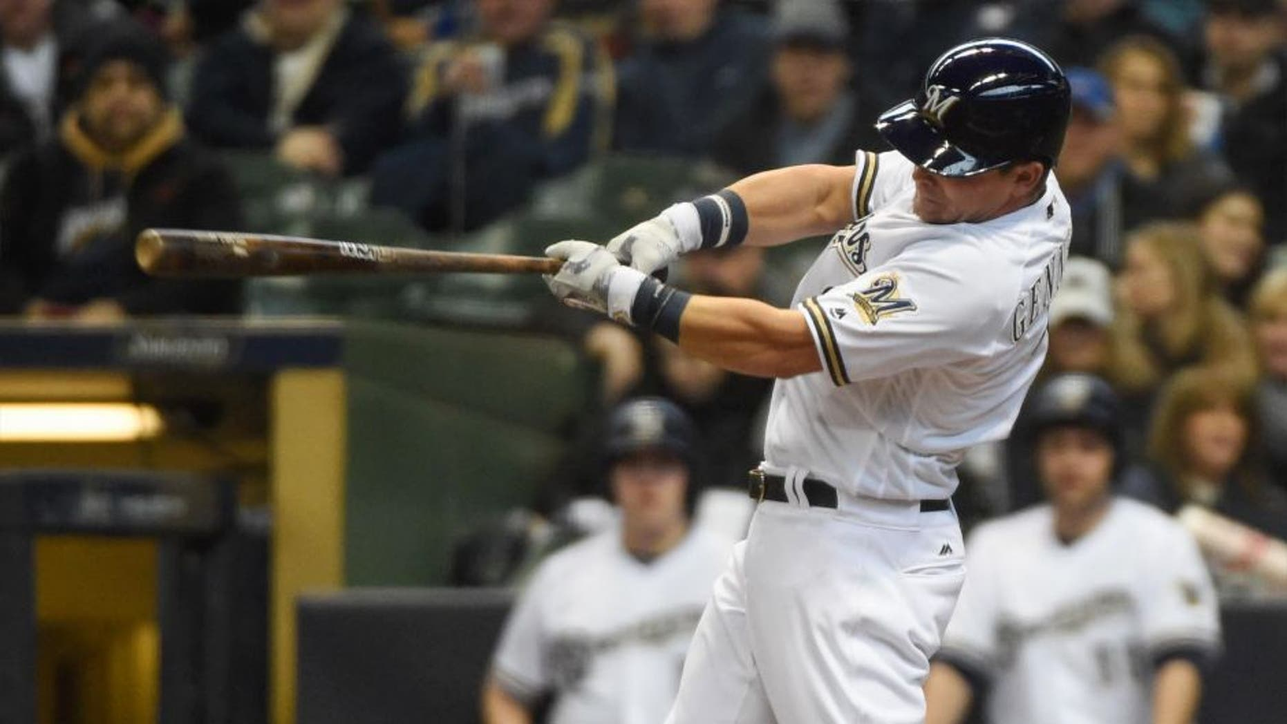 Monday, April 4: Milwaukee Brewers second baseman Scooter Gennett hits a solo home run in the second inning against the San Francisco Giants at Miller Park in Milwaukee.