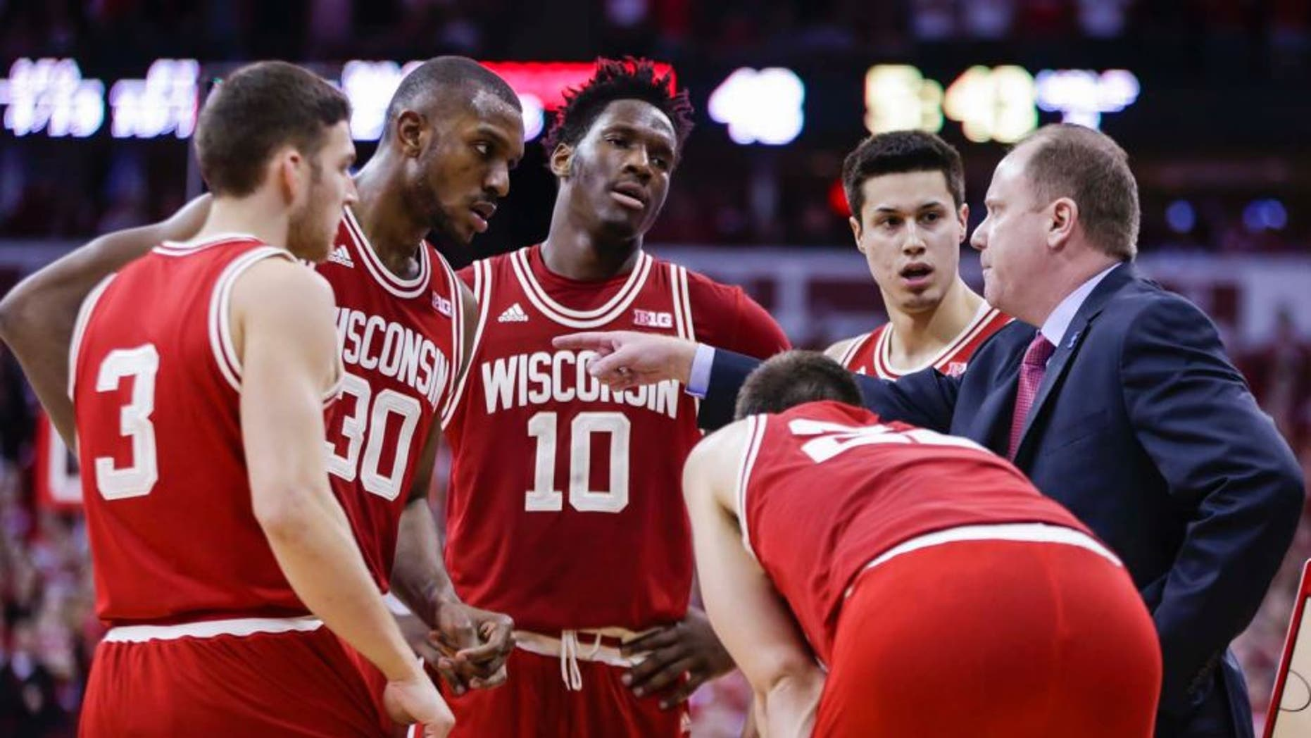 Sunday, Feb. 21: Wisconsin interim head coach Greg Gard (right) talks with (from left to right) Zak Showalter, Vitto Brown, Nigel Hayes, Bronson Koenig and Ethan Happ (bent over) during the second half against Illinois. Wisconsin won 69-60.