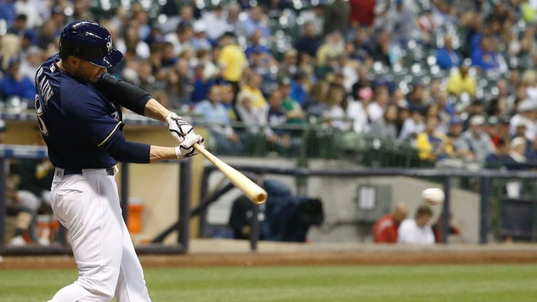 Tuesday, June 7: The Milwaukee Brewers' Ryan Braun hits a single for his 1,500th career hit during the sixth inning against the Oakland Athletics in Milwaukee. The Brewers won 5-4.