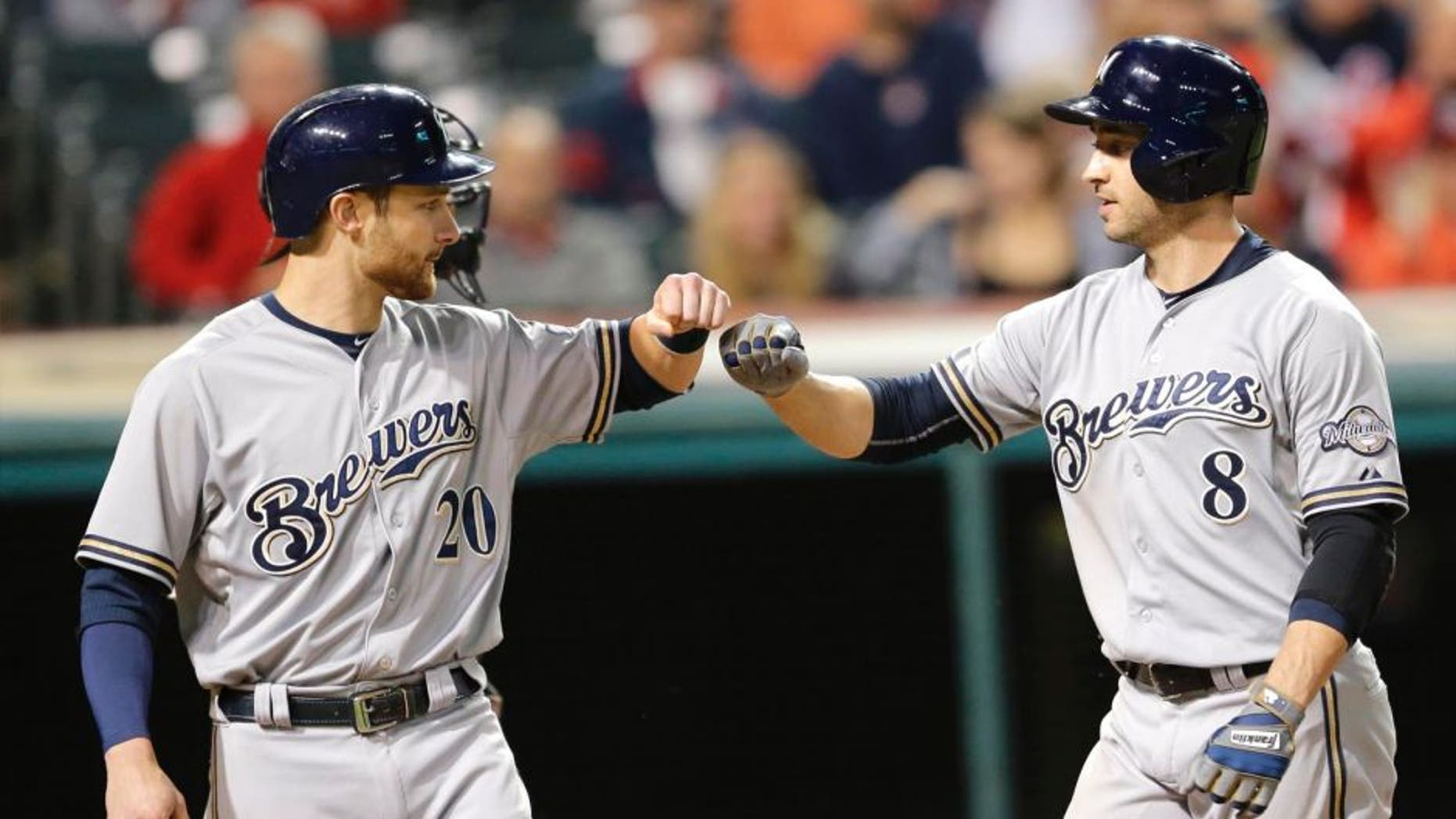 Tuesday, Aug. 25: The Milwaukee Brewers' Ryan Braun (right) is congratulated by Jonathan Lucroy after Braun hit a two-run home run off Cleveland Indians starting pitcher Josh Tomlin in the sixth inning in Cleveland.