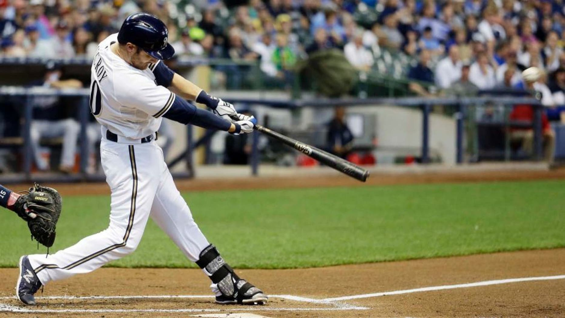 Tuesday, July 7: The Milwaukee Brewers' Jonathan Lucroy hits a home run during the first inning against the Atlanta Braves in Milwaukee.