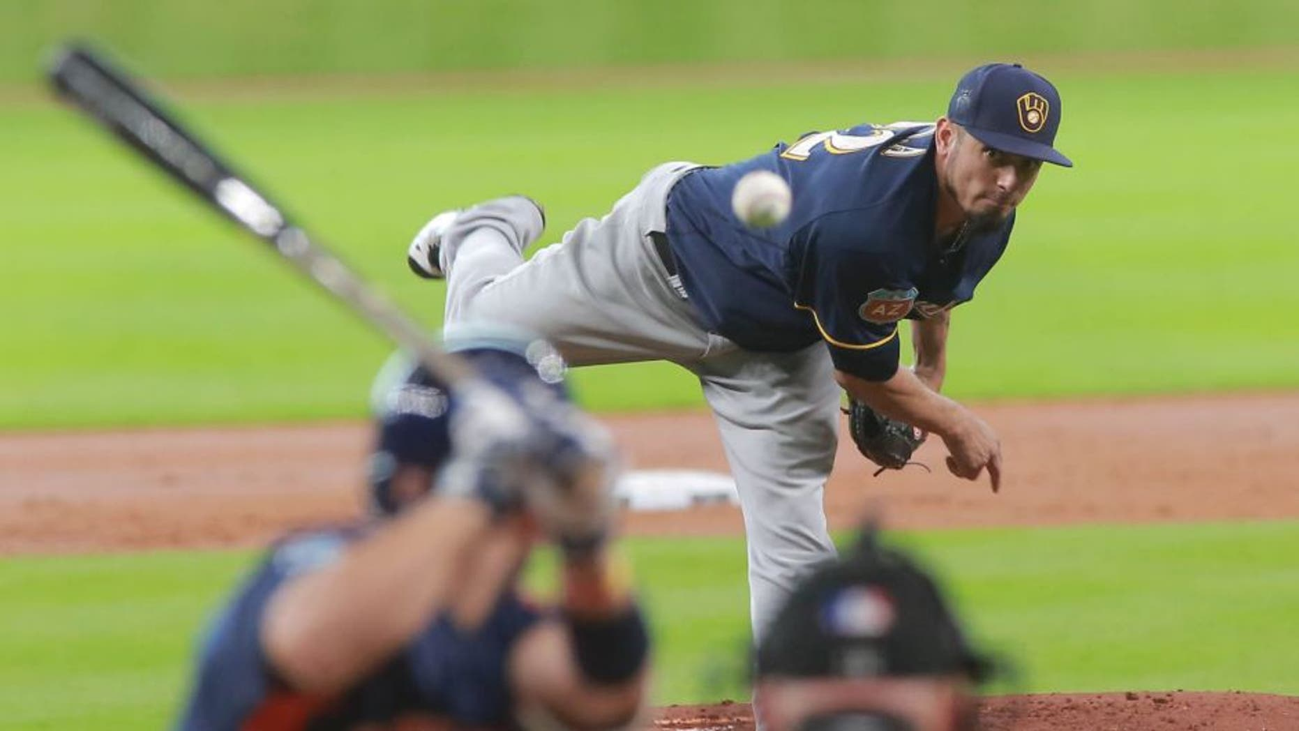 Friday, April 1: Milwaukee Brewers pitcher Matt Garza delivers a pitch to the Houston Astros' Jose Altuve in the first inning of an exhibition baseball game in Houston.
