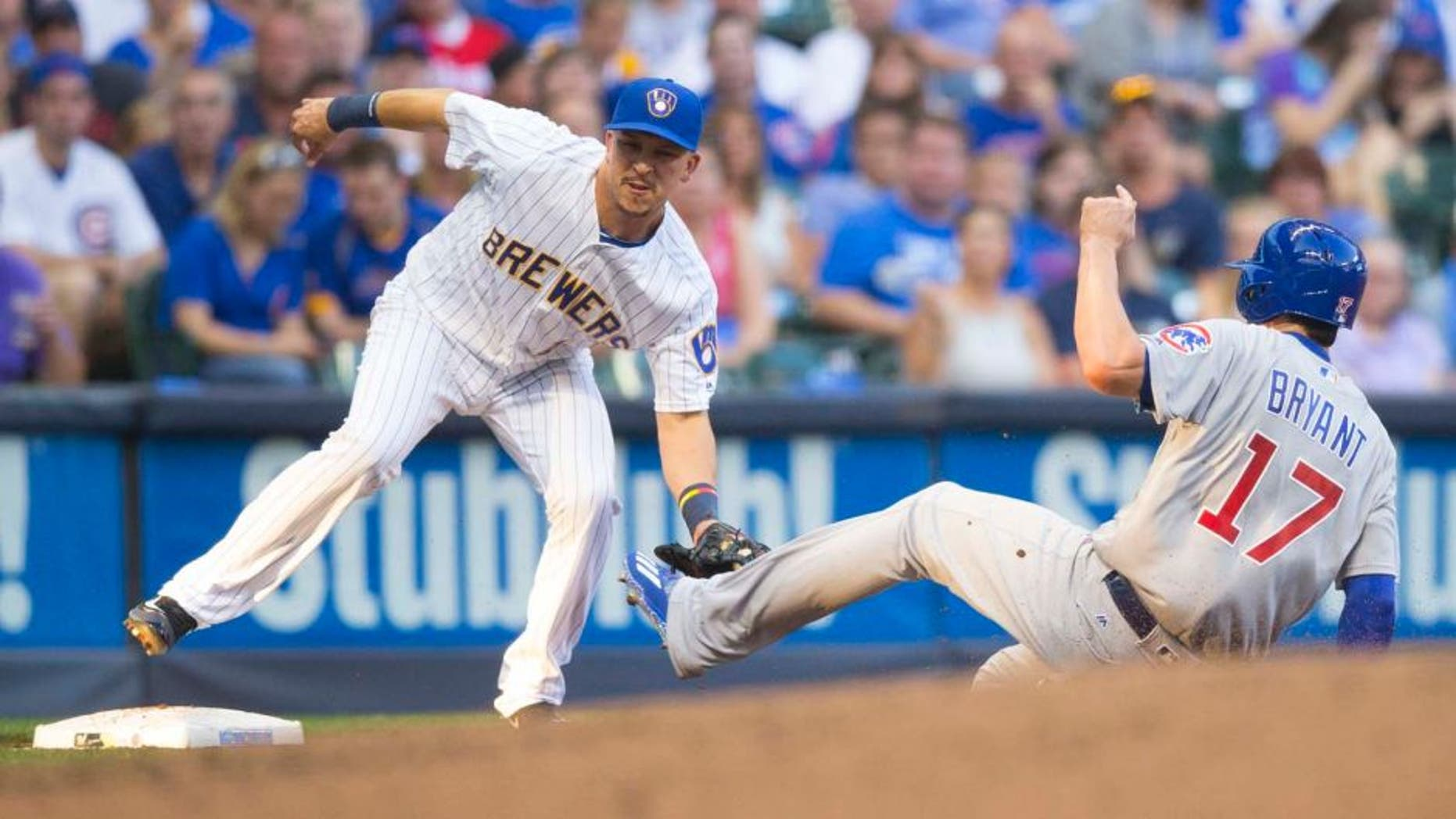 Friday, July 22, 2016: Milwaukee Brewers third baseman Hernan Perez (left) tags out Chicago Cubs third baseman Kris Bryant at third base during the second inning at Miller Park. The Brewers lost 5-2.