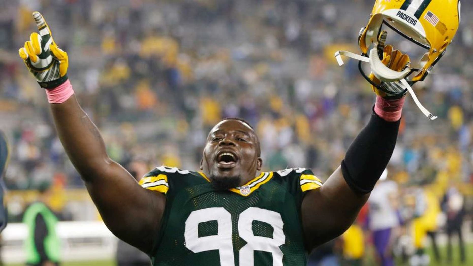 Thursday, October 2: The Green Bay Packers' Letroy Guion celebrates after the game against the Minnesota Vikings in Green Bay, Wis. The Packers won 42-10.