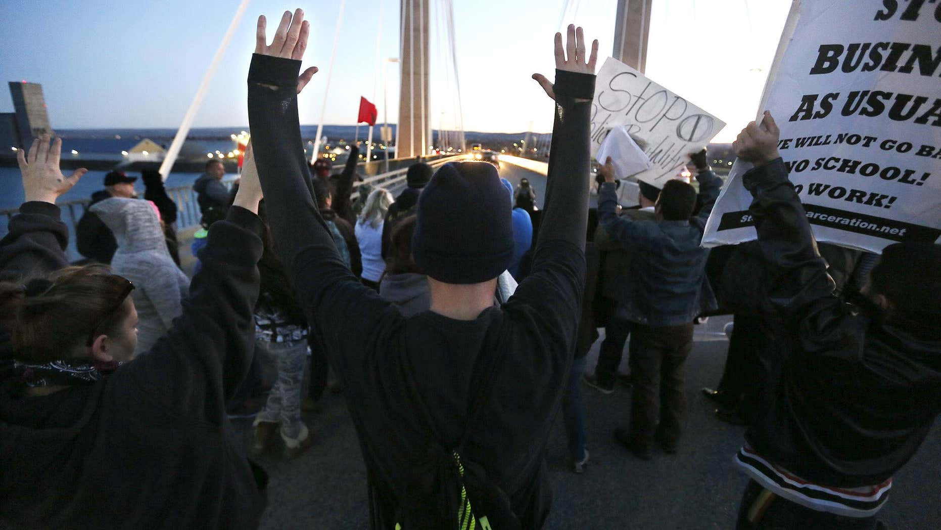 Feb. 21, 2015: Protesters hold up their hands and signs on the cable bridge.