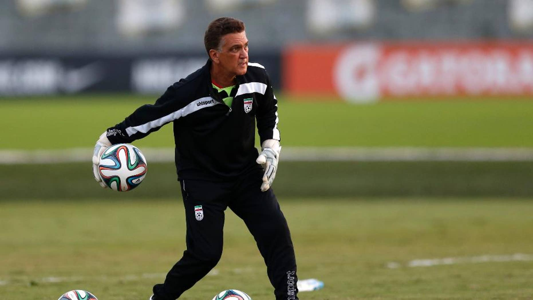 FILE - In this June 8, 2014 file photo, Iran goalkeepers coach Dan Gaspar works with goalies after an international soccer friendly against Trinidad and Tobago in Sao Paulo, Brazil. The 58-year-old Gaspar is from Connecticut. His players, however, speak mostly Farsi.  (AP Photo/Julio Cortez, File)