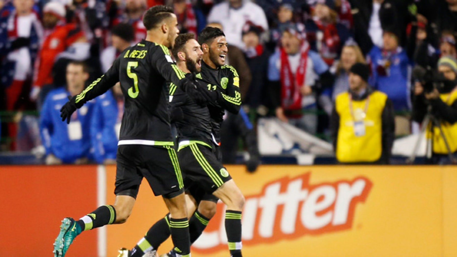 From left to right, Mexico's Diego Reyes, Miguel Layun and Carlos Vela celebrate their goal against the United States during the first half of a World Cup qualifying soccer match Friday, Nov. 11, 2016, in Columbus, Ohio. (AP Photo/Jay LaPrete)