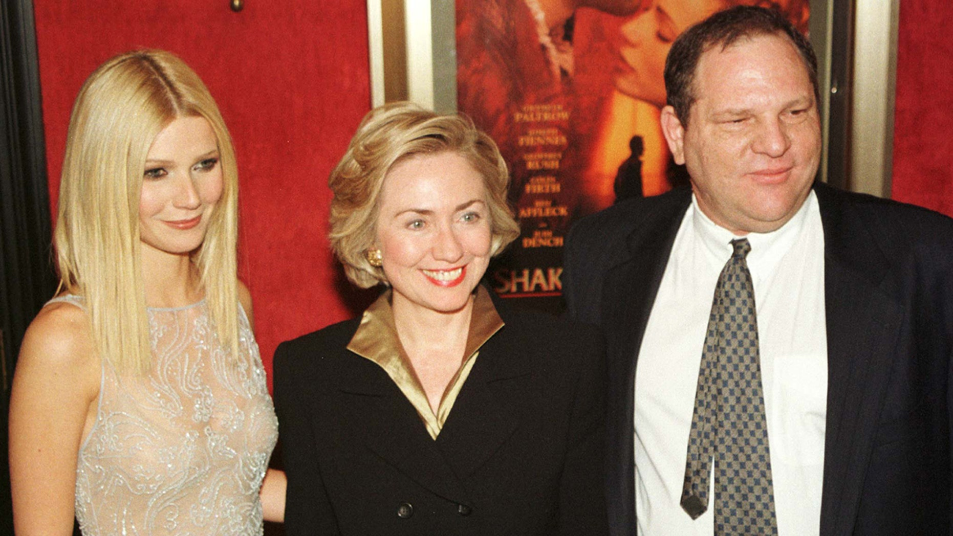 """Gwyneth Paltrow (L) poses with then-first lady Hillary Rodham Clinton (C) and former Miramax co-chairman Harvey Weinstein as they arrive for the premiere of """"Shakespeare in Love"""" in New York on December 3, 1998."""