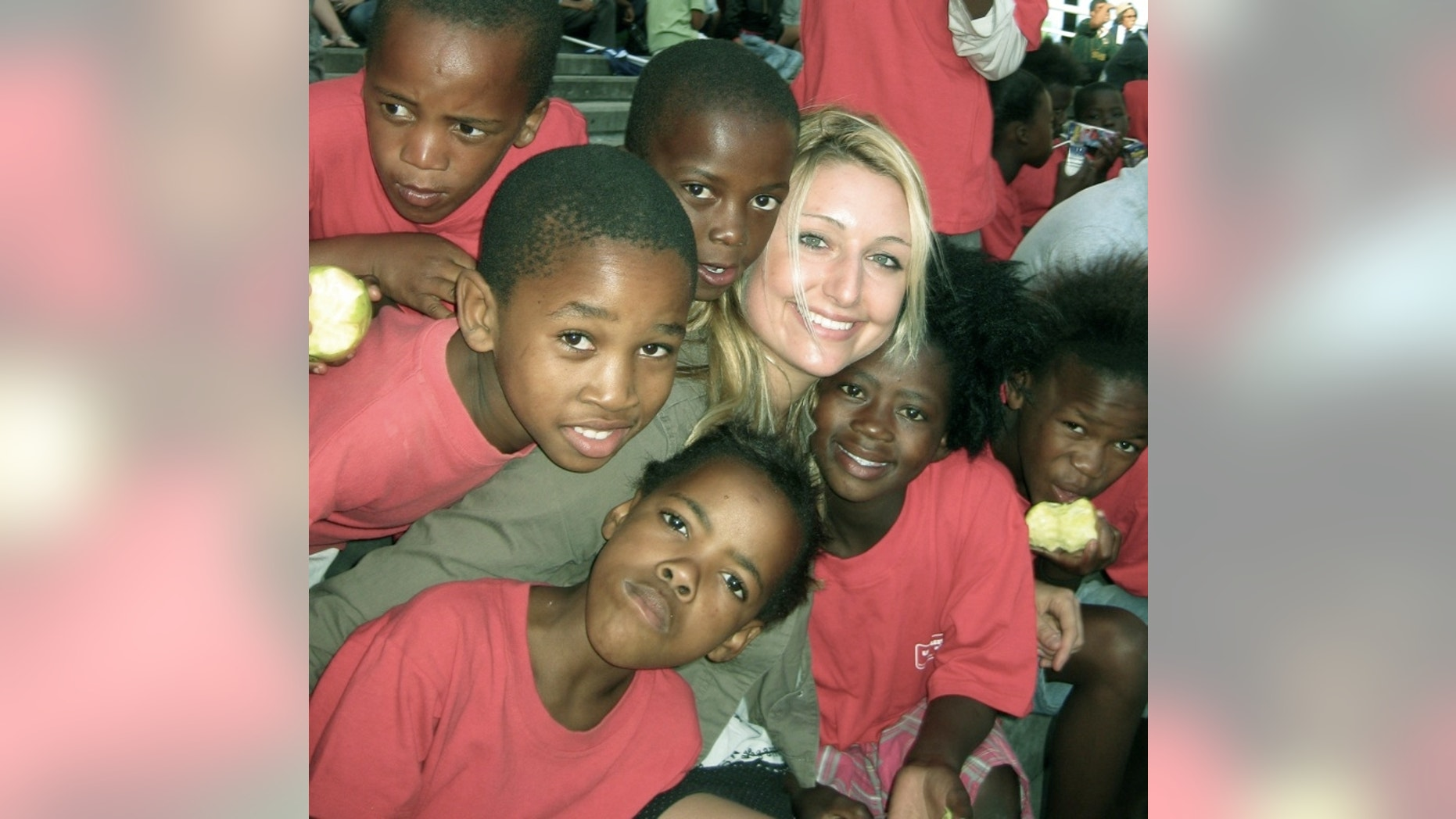 Whitney Johnson, surrounded by the children of Ubuntu.