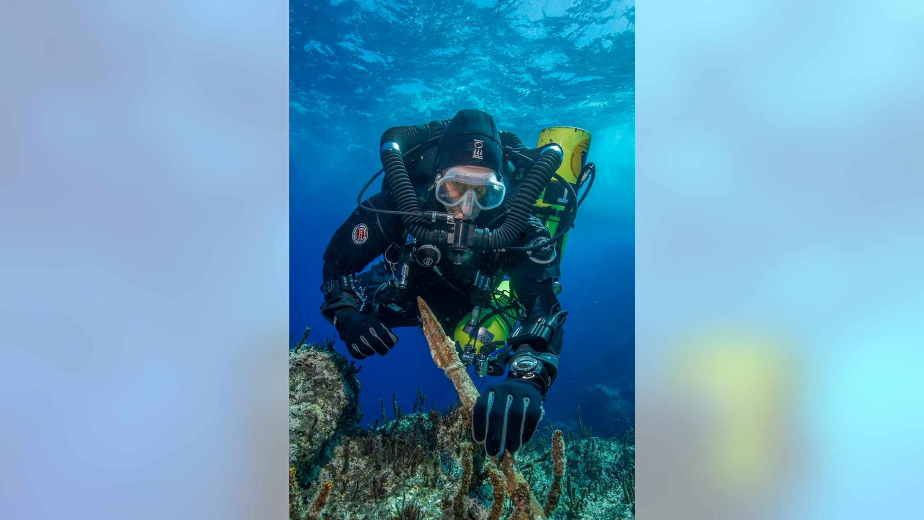 """Philip Short, the project chief diver of the """"Return to Antikythera"""" mission, inspects the 6.5-foot-long bronze spear recovered from the wreck."""