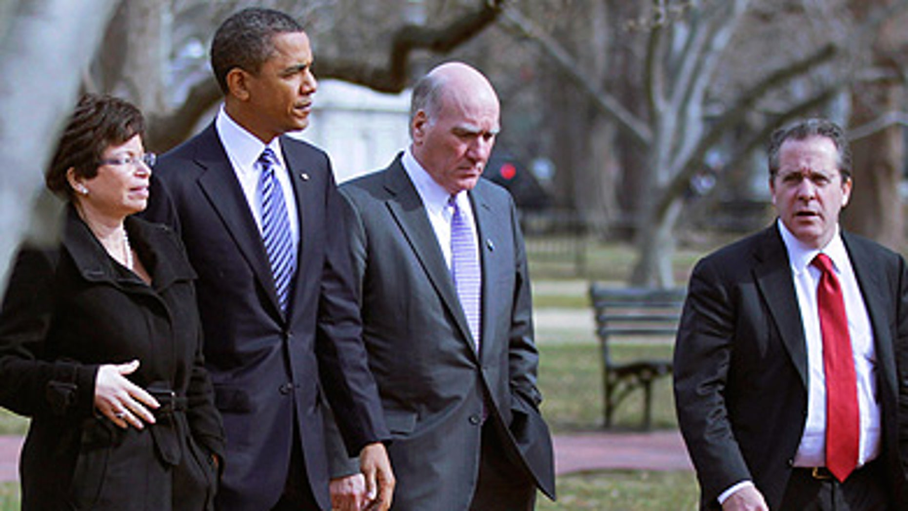 Monday: President Obama is surrounded by Senior adviser Valerie Jarrett, Chief of Staff Bill Daley and National Economic Council Director Gene Sperling while walking back to the White House from the U.S. Chamber of Commerce.