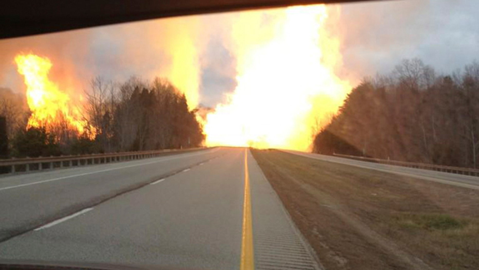Dec. 11, 2012: This image provided by the Kanawha County Emergency Services shows flames erupting across Interstate 77 from a gas line explosion in Sissonville, W. Va.