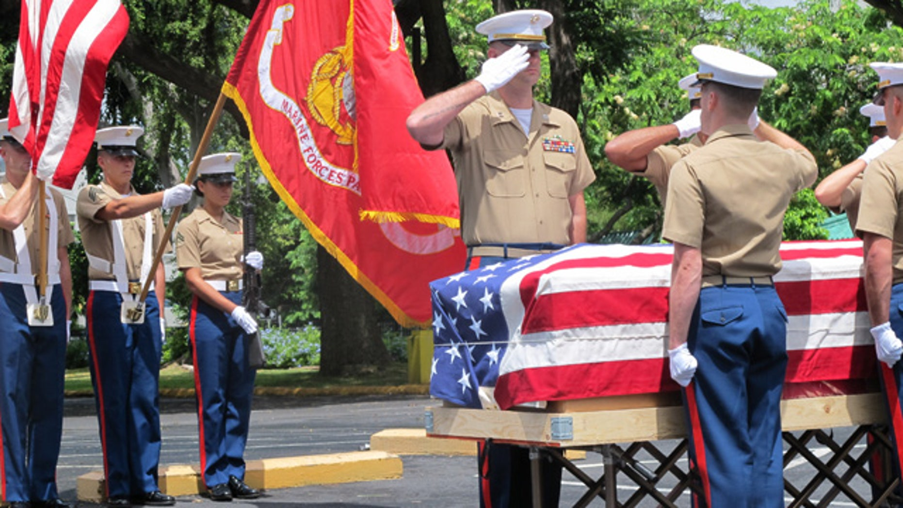 Sept. 24, 2015: United States Marines salute during a ceremony in Honolulu for the departure of 1st Lt. Alexander Bonnyman's remains. (AP Photo/Audrey McAvoy)