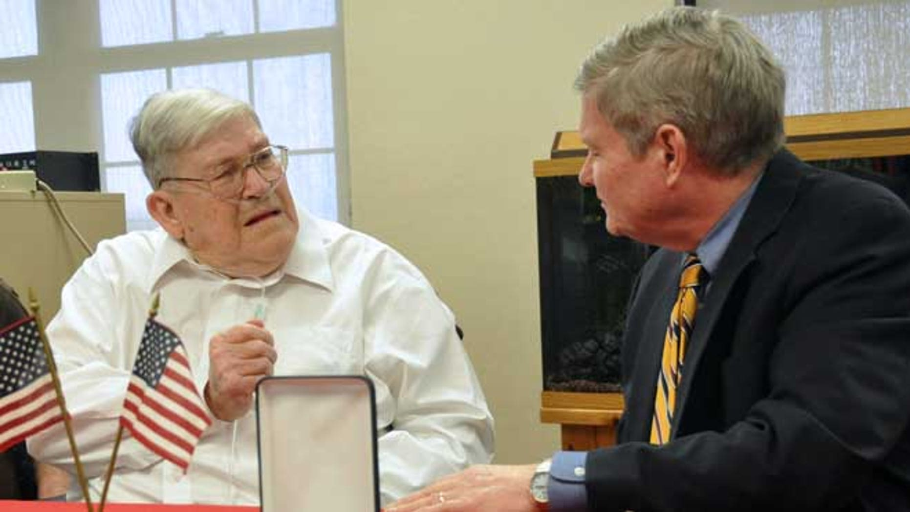 May 1, 2013: World War II veteran Charles Bledsoe, 88, left, talks with U.S. Sen. Tim Johnson, D-S.D., as he's awarded a Purple Heart and Bronze Star for injuries sustained in combat  at the Veterans Administration hospital in Sioux Falls, S.D.