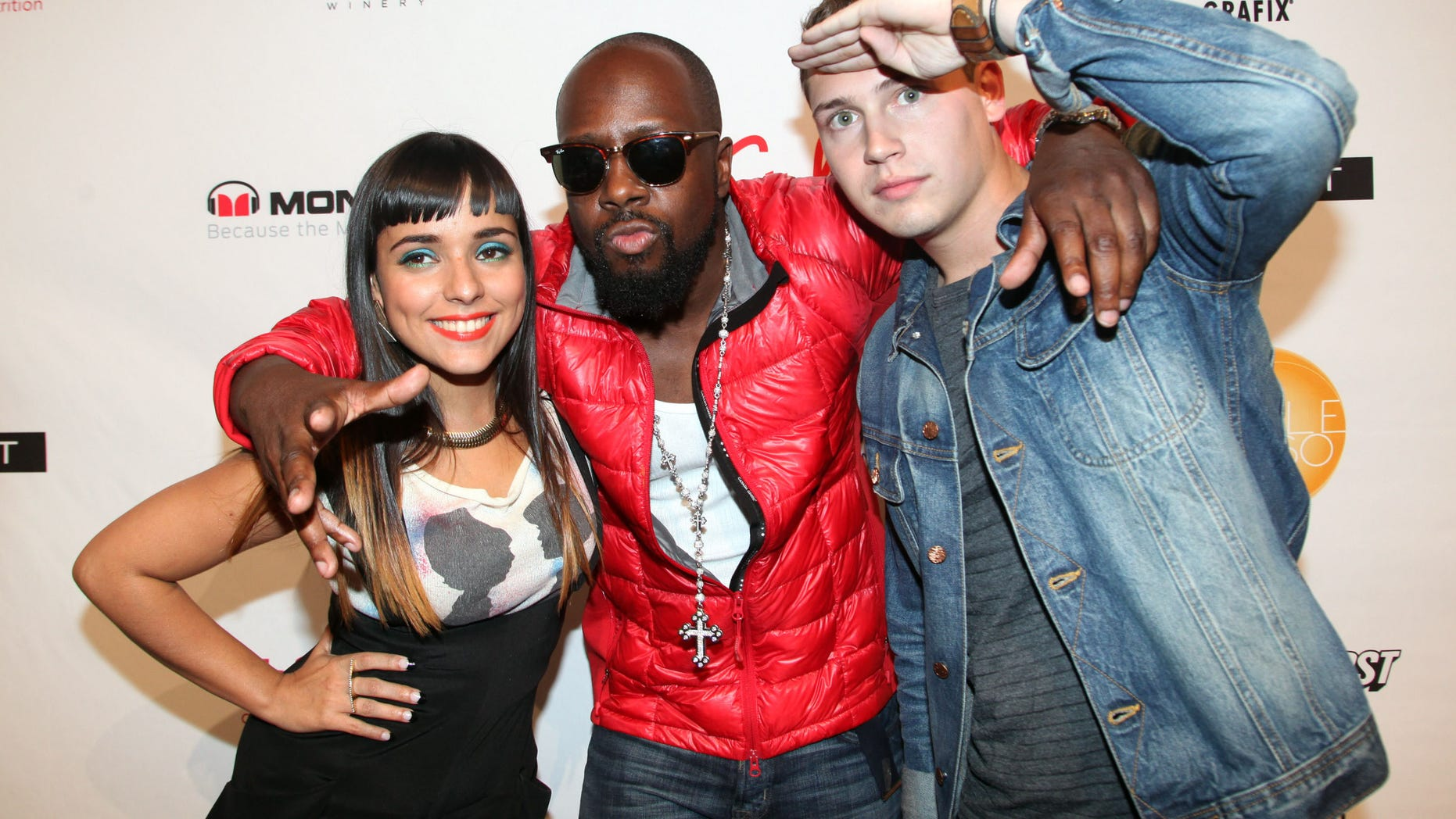"Sept. 12, 2012: Recording artists Jarina De Marco, Wyclef Jean and Cris Cab at ""Boy Meets Girl"" By Stacy Igel and  Lockerz Spring 2013 collection at the Metropolitan Pavilion in New York City."