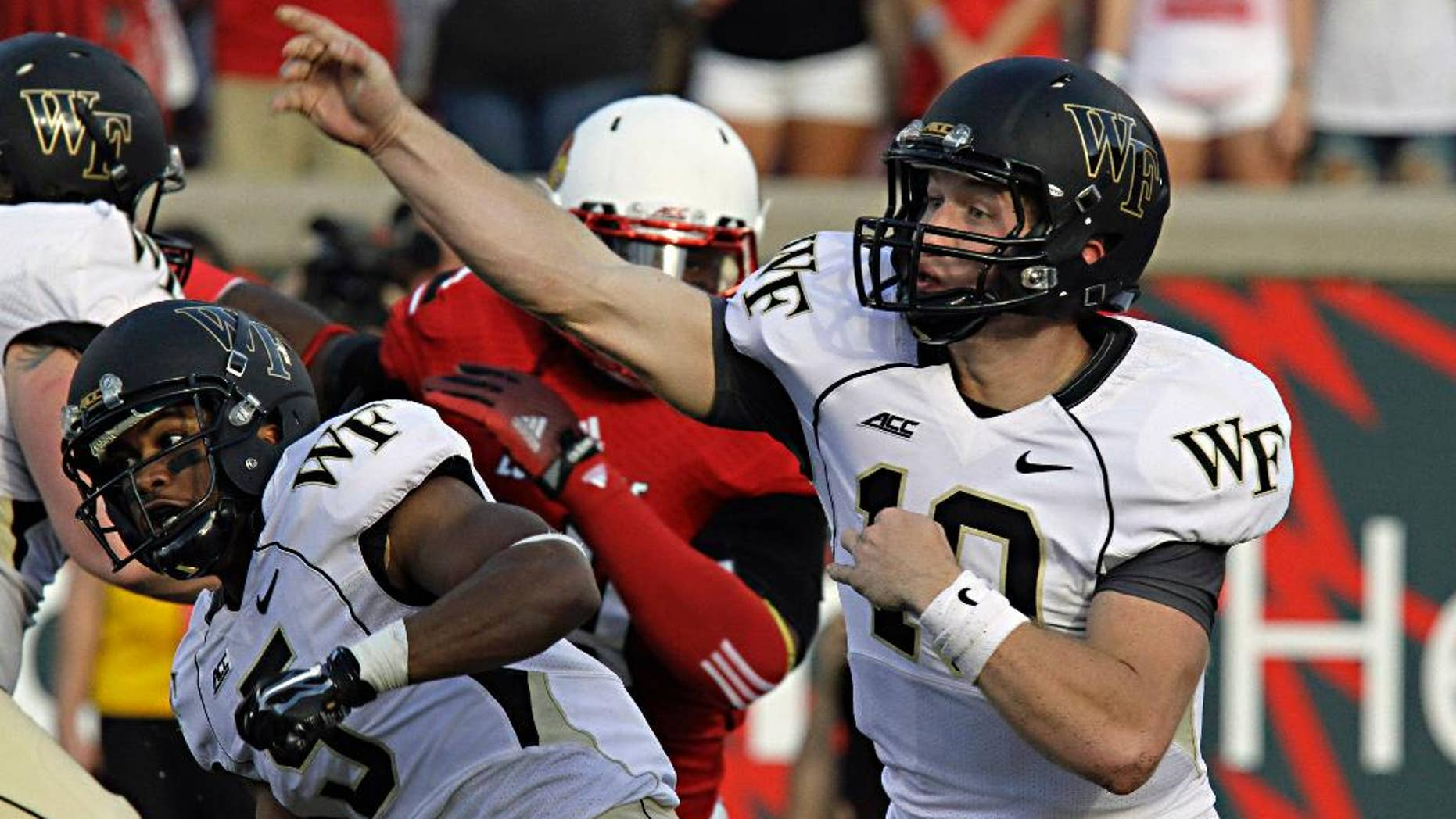 Wake Forest quarterback John Wolford launches a pass attempt against Louisville in their NCAA college football game in Louisville, Ky., Saturday, Sept. 27, 2014. Wolford completed 19 of 34 passes and threw three interceptions in the 20-10 Louisville victory. (AP Photo/Garry Jones)