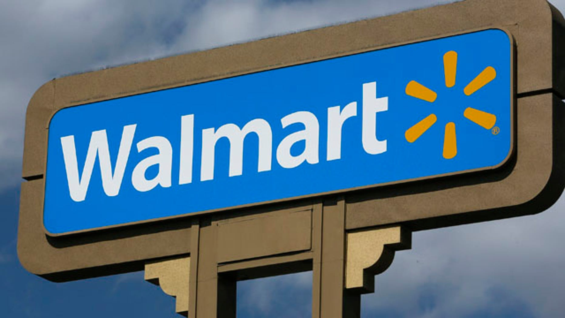 FILE - This May 28, 2013 file photo shows a sign outside a Wal-mart store in Duarte, Calif. (AP Photo/Damian Dovarganes, File)