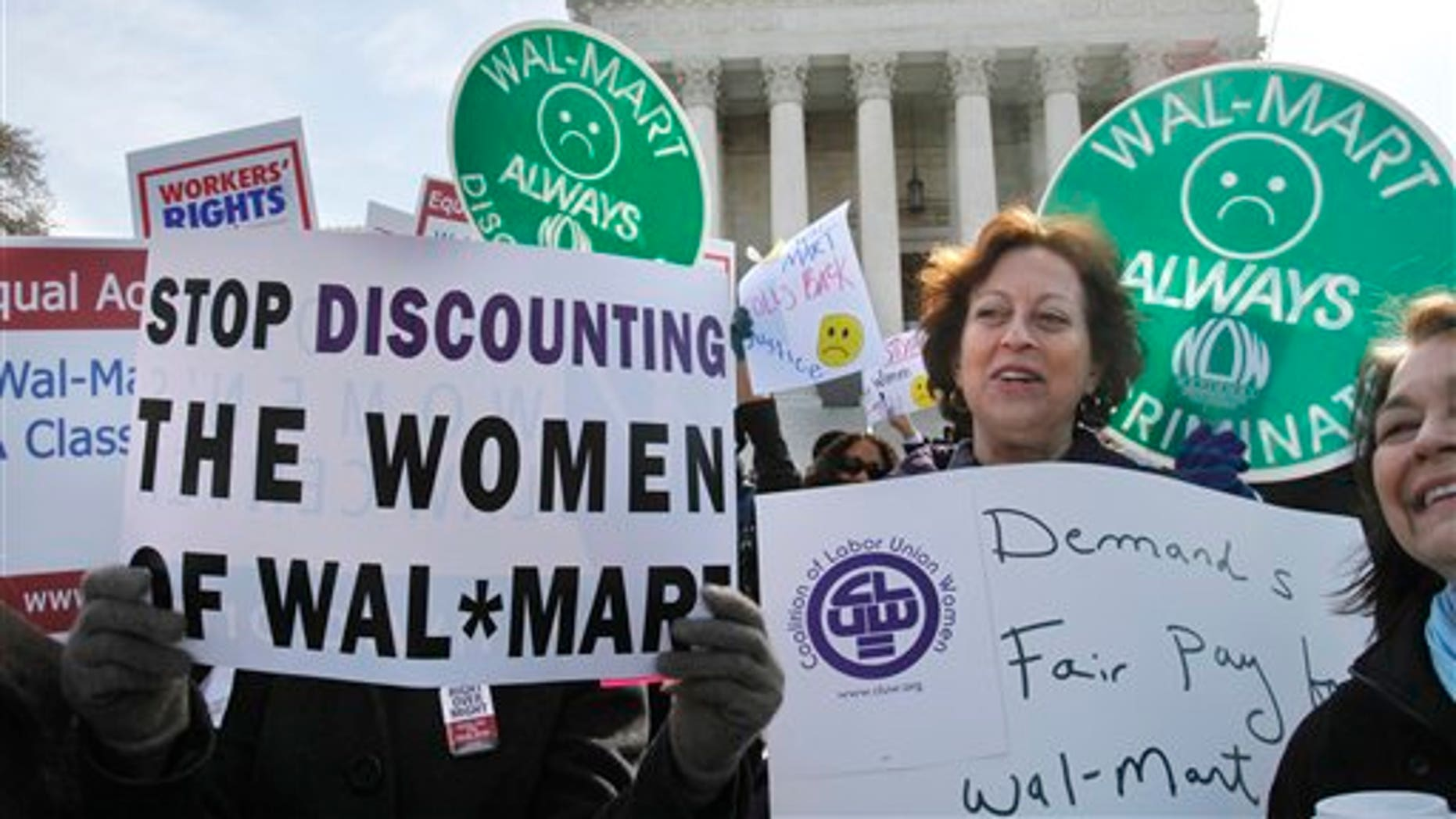 March 30: Protestors rally outside the Supreme Court in Washington, supporting plaintiffs in a case of women employees against Walmart.