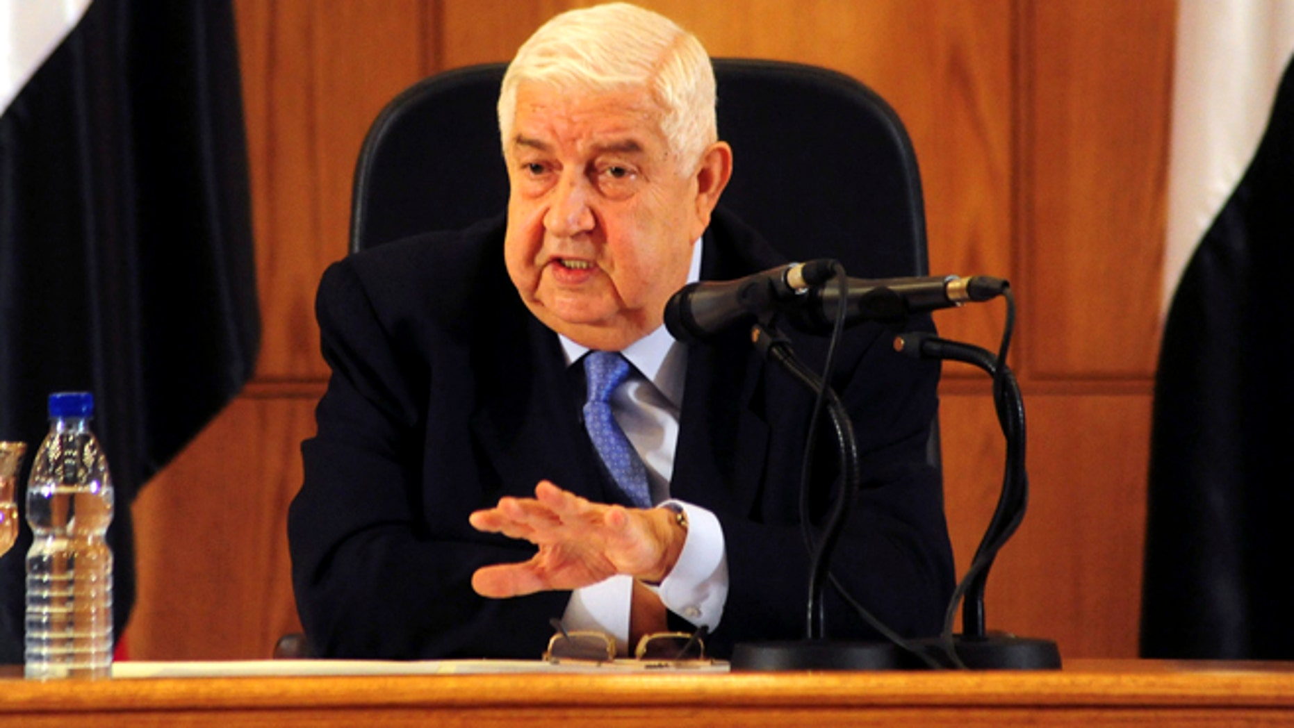 August 25, 2014: In this photo released by the Syrian official news agency SANA, Syrian Foreign Minister Walid al-Moallem speaks during a press conference, giving the first public comments by a senior Assad official on the threat posed by the Islamic State group, in Damascus, Syria. Al-Moallem warned the U.S. not to conduct airstrikes inside Syria against the Islamic State group without Damascus consent, saying any such attack would be considered an aggression. Al-Moallem also said that Syria is ready to work with regional states and the international community amid the onslaught of Islamic militants there and in Iraq, adding that the Syrian government is a crucial partner in the war on terror.