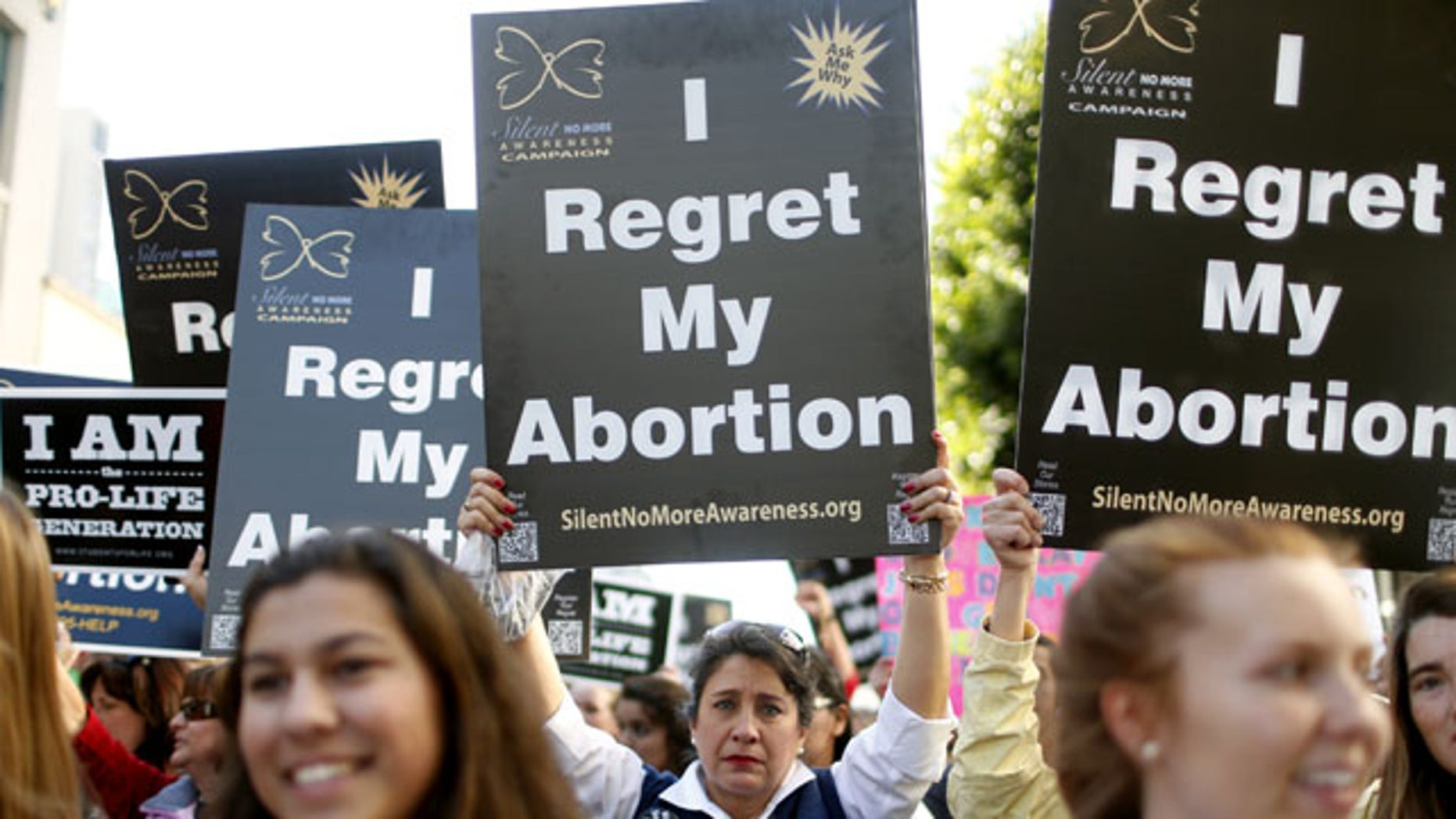 """January 25, 2014: Abortion opponent Georgette Forney holds a sign stating """"I regret my abortion"""" during the """"Walk for Life"""" rally and march in San Francisco. (AP)"""