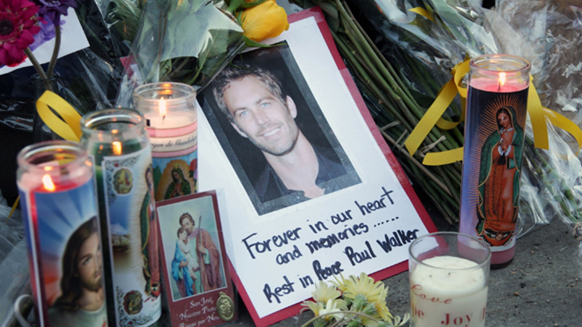 VALENCIA, CA - DECEMBER 01:  A general view of atmosphere as fans pay tribute to actor Paul Walker at the site of his fatal car accident on December 1, 2013 in Valencia, California.  Walker died on November 30, 2013 at age 40. (Photo by David Buchan/Getty Images)