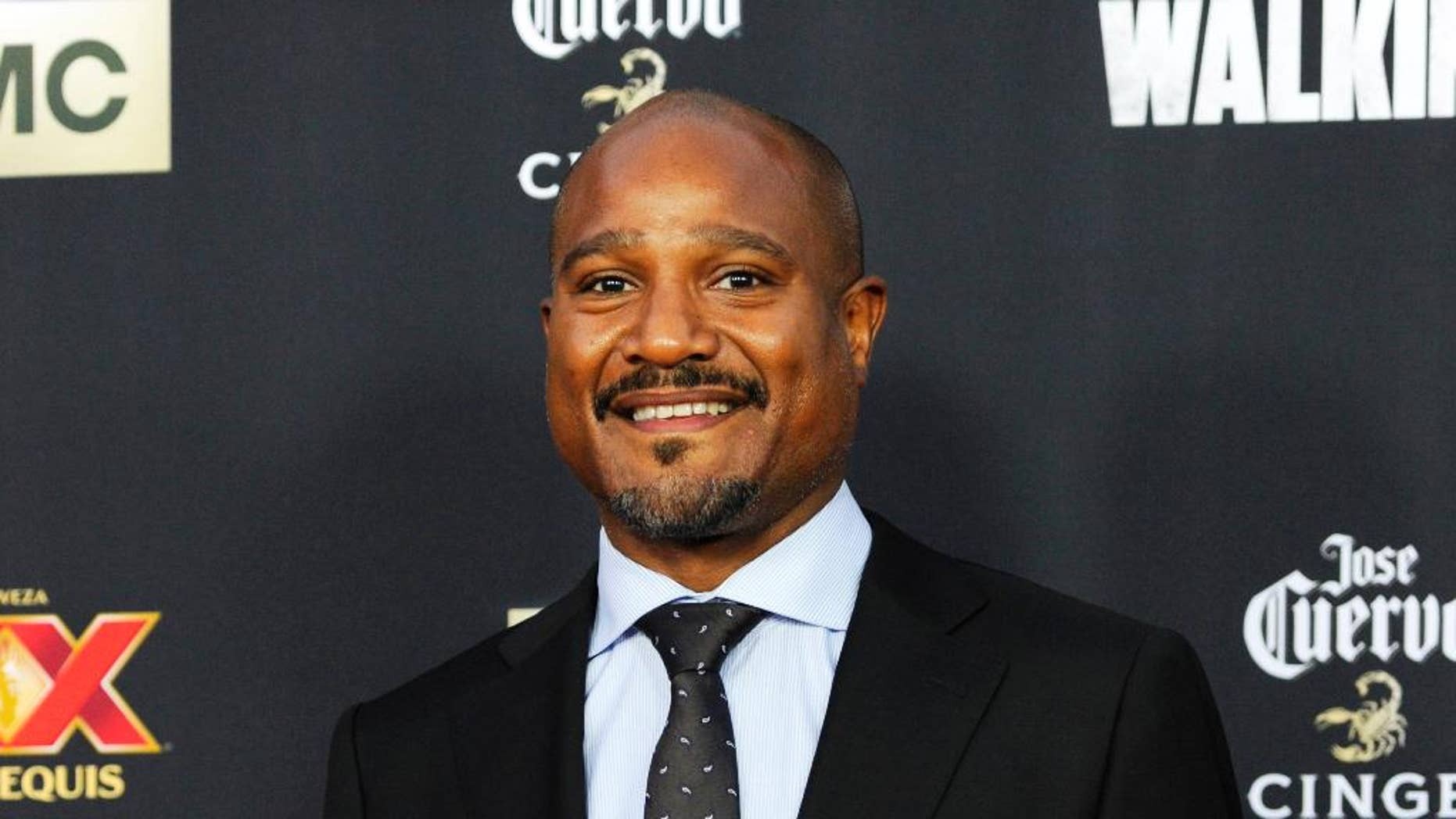 """FILE - In this Oct. 2, 2014 file photo, Seth Gilliam, a cast member in """"The Walking Dead,"""" poses at a special screening for season five of the show in Universal City, Calif. Gilliam is facing drunken driving and drug charges after police say he was clocked on radar at 107 mph while passing a police officer who was running radar on a Georgia highway. Police say 46-year-old Gilliam was stopped shortly after 2 a.m. Sunday, May 3, 2015, on Georgia 74 in the Peachtree City area, not far from the set where much of the TV show is filmed in nearby Senoia. (Photo by Chris Pizzello/Invision/AP, File)"""