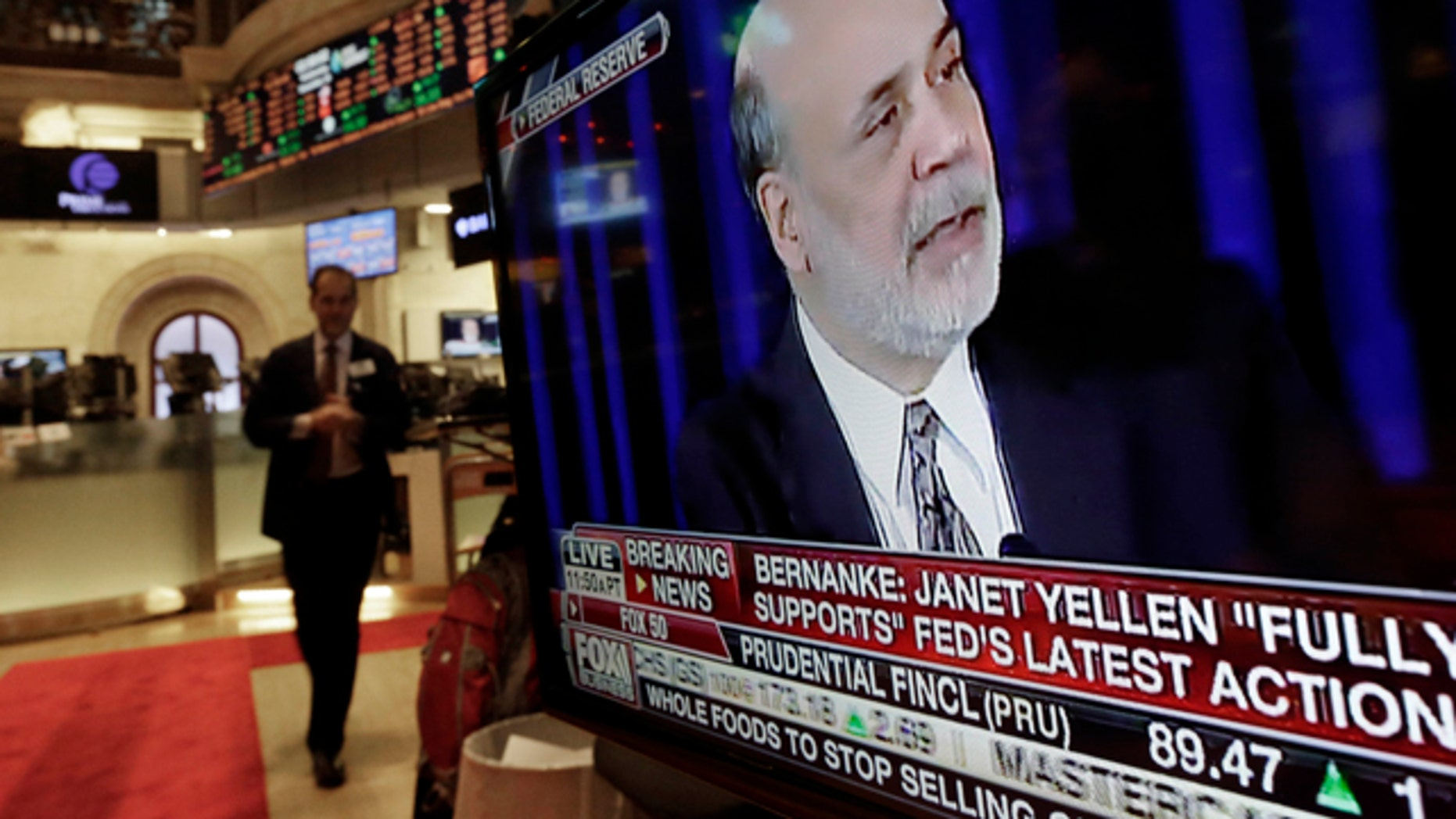 The news conference of Federal Reserve Chairman Ben Bernanke appears on a television screen at a trading post on the floor of the New York Stock Exchange, Wednesday, Dec. 18, 2013. The Federal Reserve has decided to reduce its stimulus for the U.S. economy because the job market has shown steady improvement. The Fed will trim its $85 billion a month in bond purchases by $10 billion starting in January.  (AP Photo/Richard Drew)