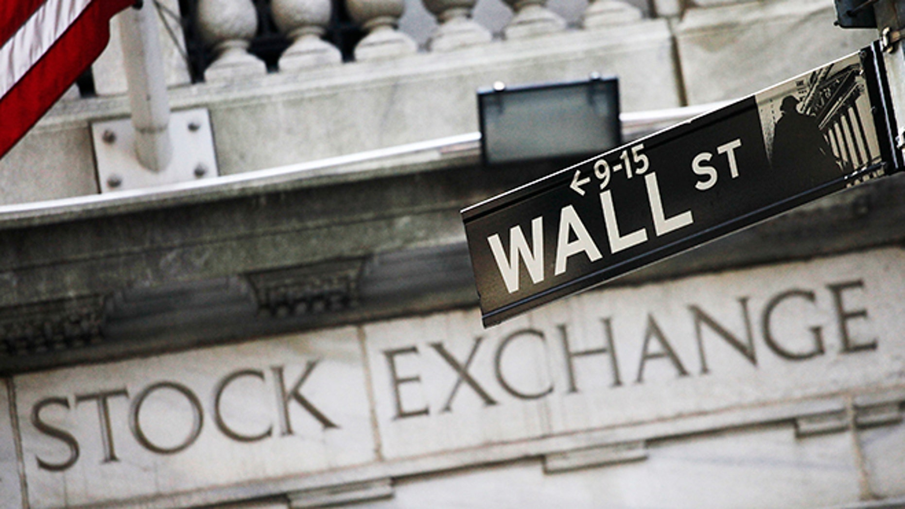 FILE - This July 16, 2013, file photo, shows a Wall Street street sign outside the New York Stock Exchange. U.S. stocks edged mostly lower in midday trading Thursday, Nov. 19, 2015, as traders weighed a mix of company earnings news. Health care stocks were among the biggest decliners after UnitedHealth Group cut its earnings forecast. Payments company Square soared in its market debut. (AP Photo/Mark Lennihan, File)