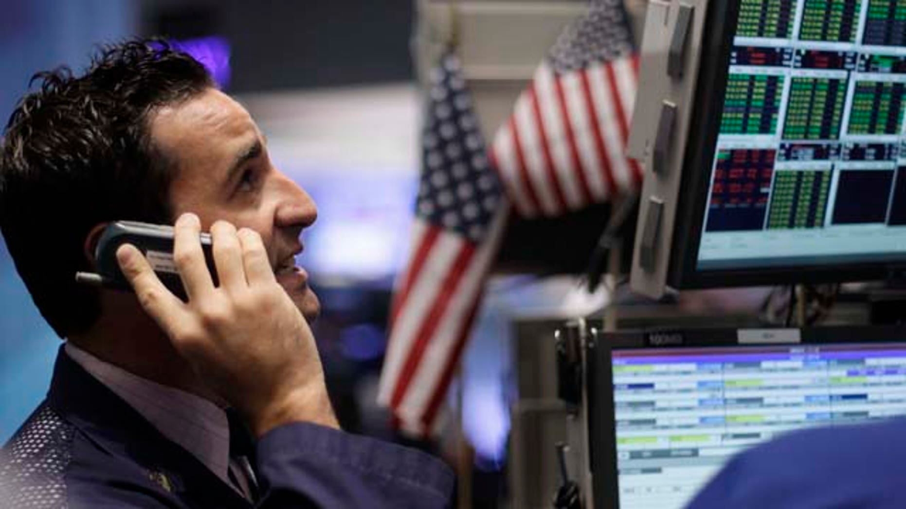 A specialist works at the New York Stock Exchange, Friday, Sept. 23, 2011 in New York. Investors fear that a global recession may already be under way. (AP Photo/Mark Lennihan)