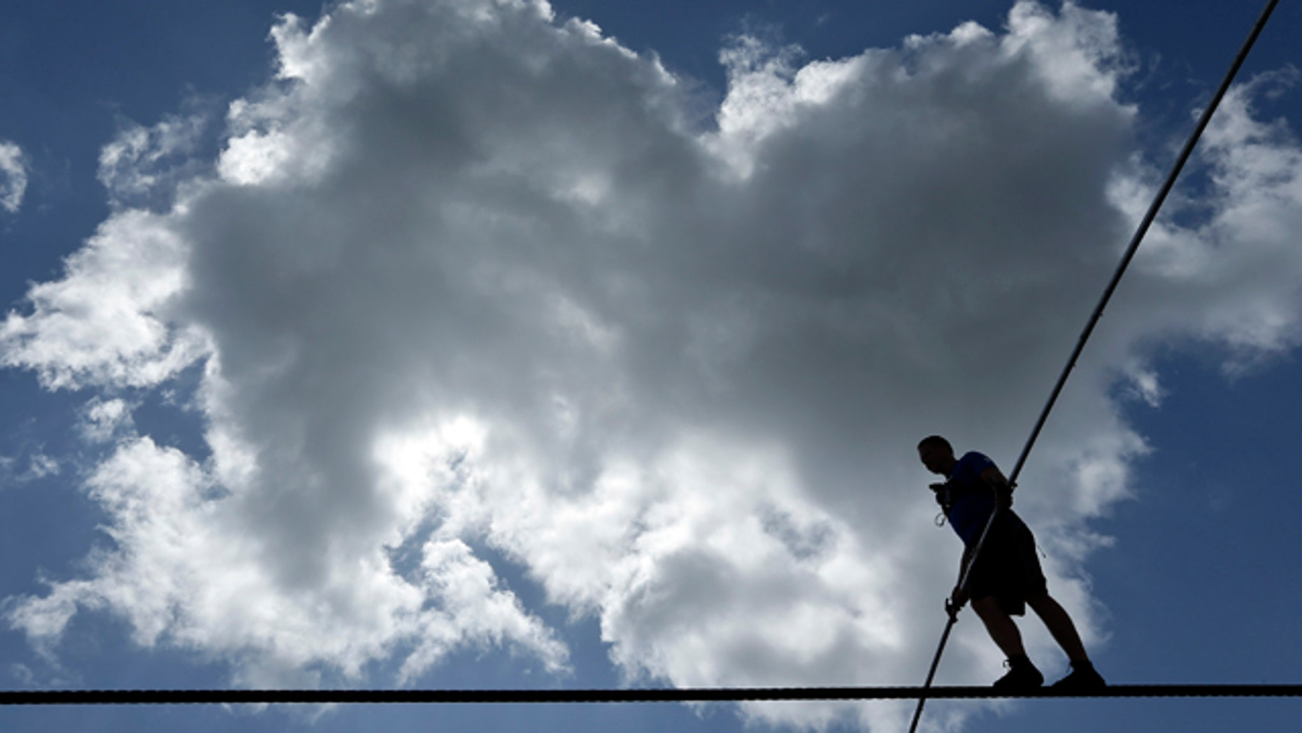 June 18, 2013: High wire performer Nik Wallenda walks across a wire as he practices in Florida.