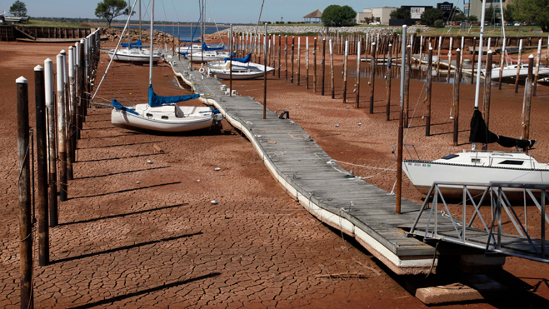 Sept. 30, 2011: In this file photo, Sailboats and a floating dock lie on the dry, cracked dirt in a harbor at Lake Hefner in Oklahoma City as drought continues to be a problem across the state.