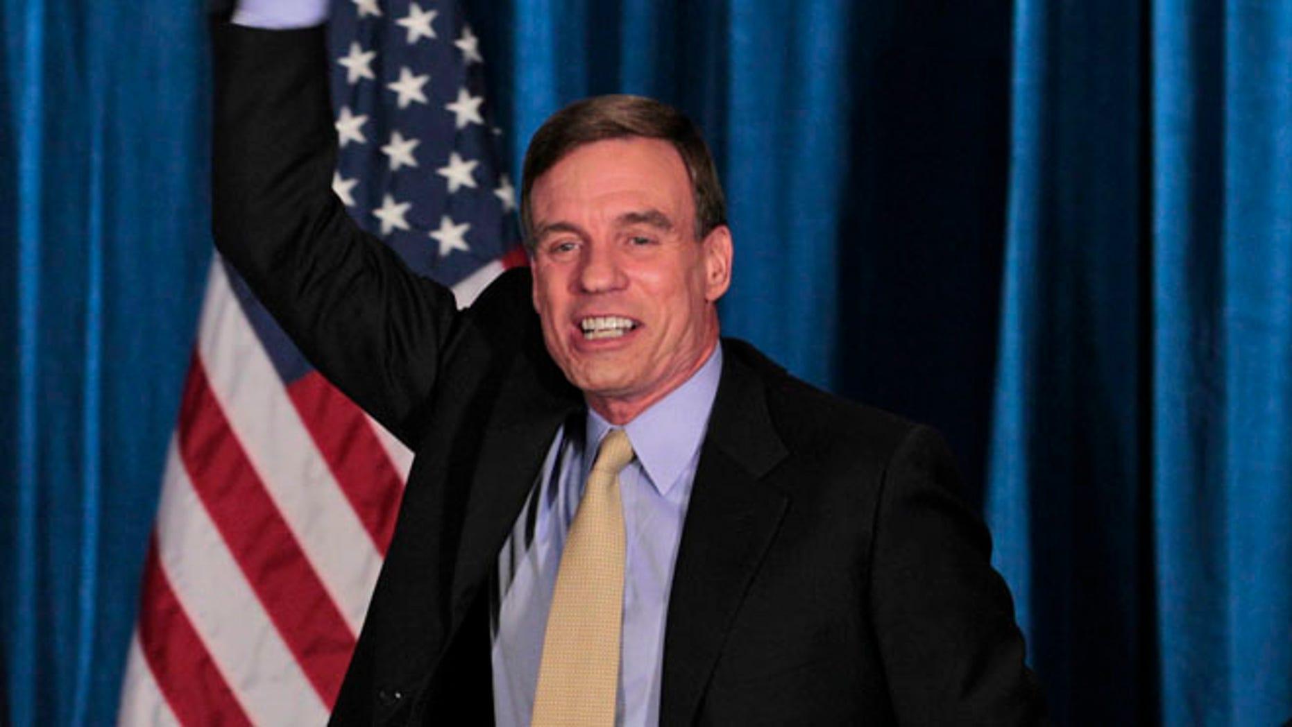 FILE: Nov. 7, 2012: Sen. Mark Warner, D-Va., celebrates Sen.-elect Timothy Kaine's win at victory party in Richmond, Va.