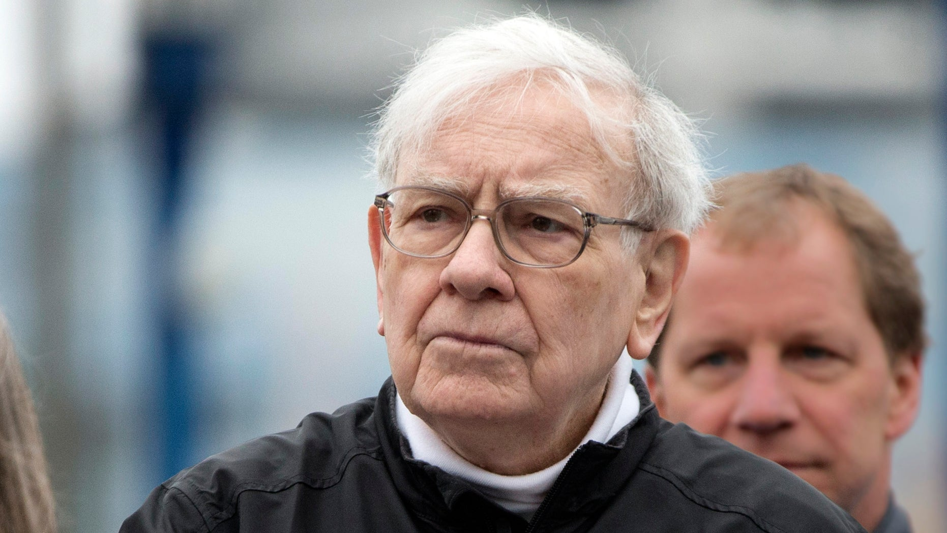 Investor Warren Buffett places a hand on his heart during the playing of the national anthem prior to launching a 5K run and walk organized by the Brooks Running Company, a Berkshire Hathaway subsidiary, in Omaha, Neb., Sunday, May 5, 2013. The Berkshire Hathaway shareholders meeting is being held this weekend in Omaha. (AP Photo/Nati Harnik)
