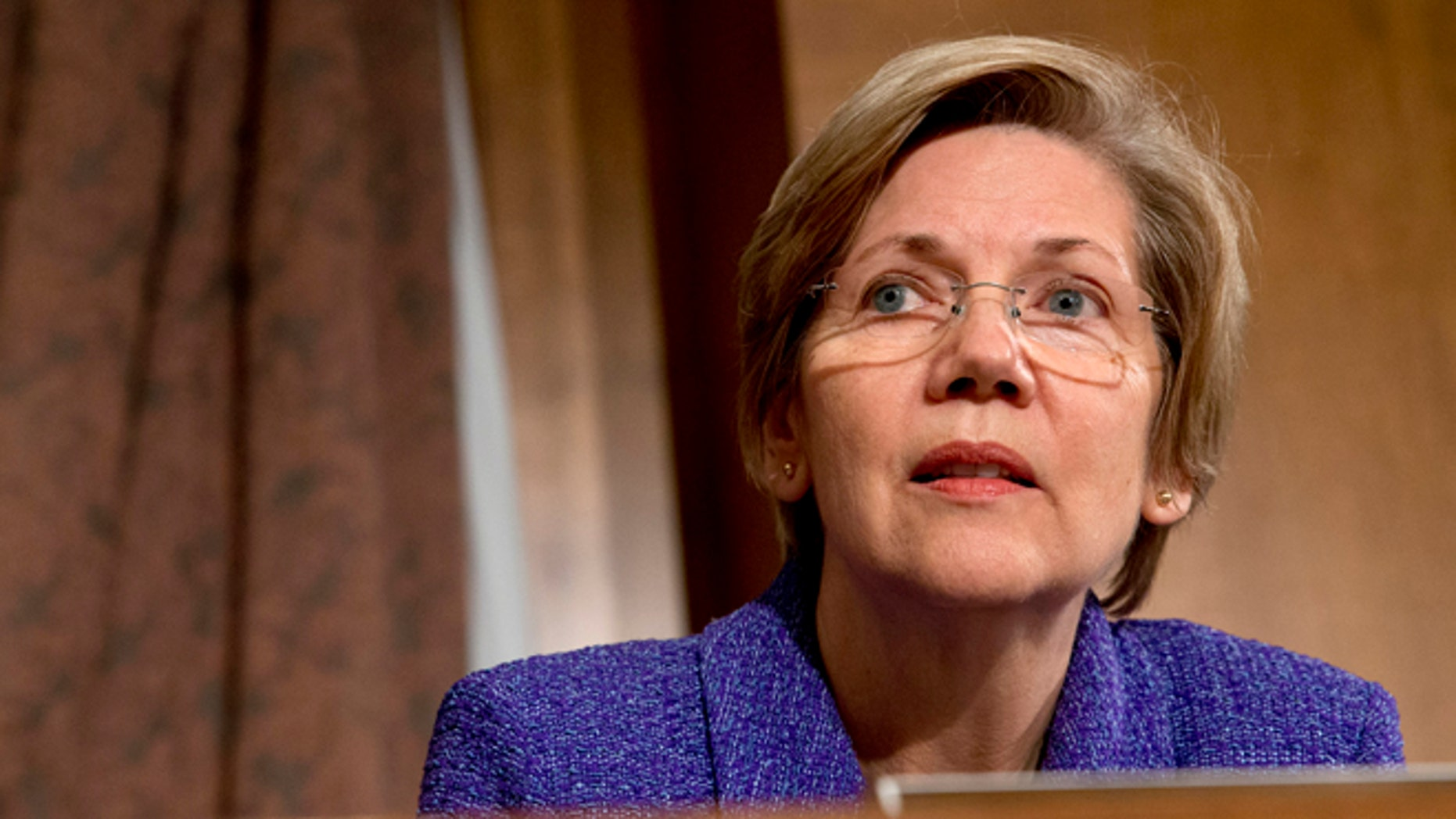 FILE: Tuesday Nov. 12, 2013: Senate Banking Committee member Sen. Elizabeth Warren, D- Mass. listens to testimony on Capitol Hill, in Washington, D.C.