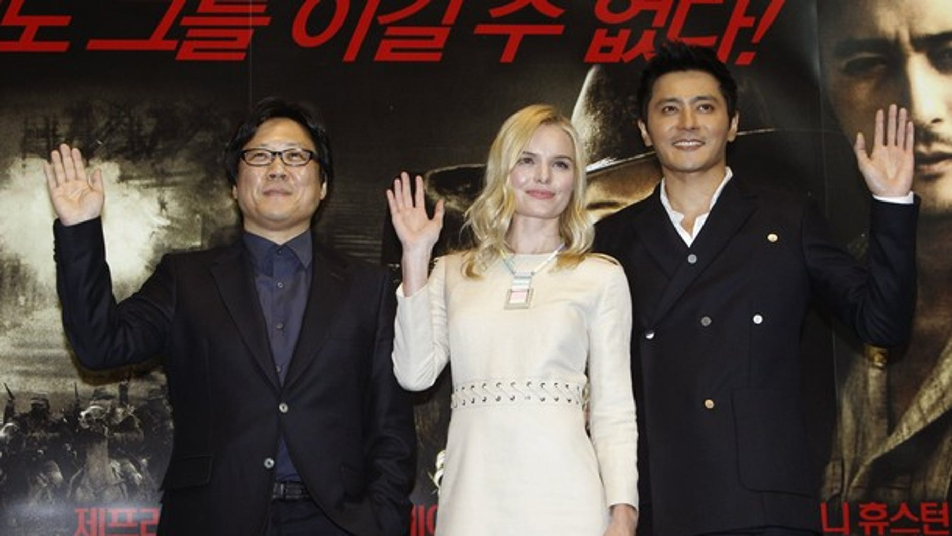Nov. 22: Director Sngmoo Lee, actress Kate Bosworth and actor Jang Dong-gun pose during a media preview for their new movie 'The Warrior's Way' at a theater in Seoul. (Reuters)