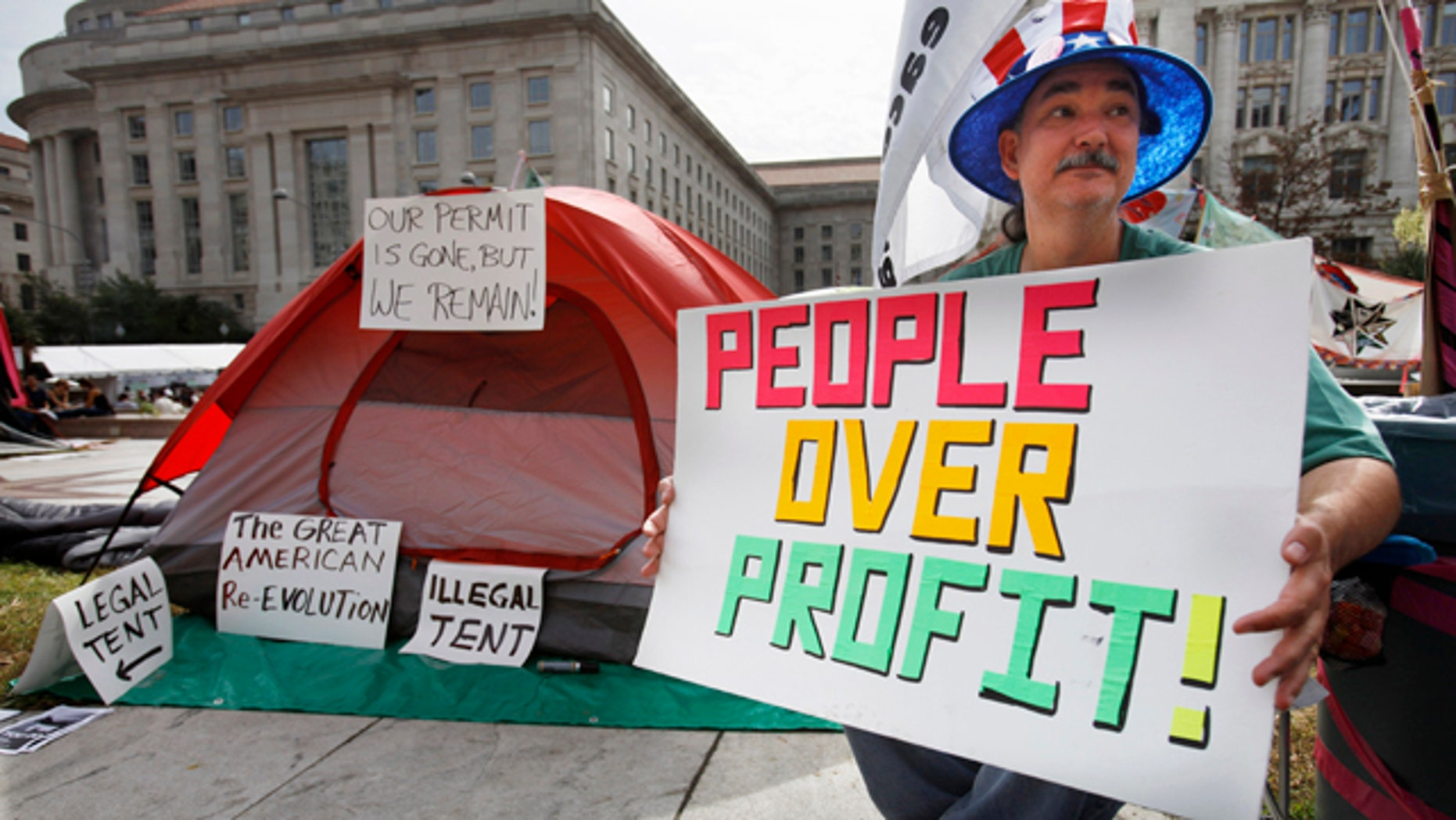 Oct. 10, 2011: Cameron Halket of Dallas sits by his tent set up at Freedom Plaza in Washington.