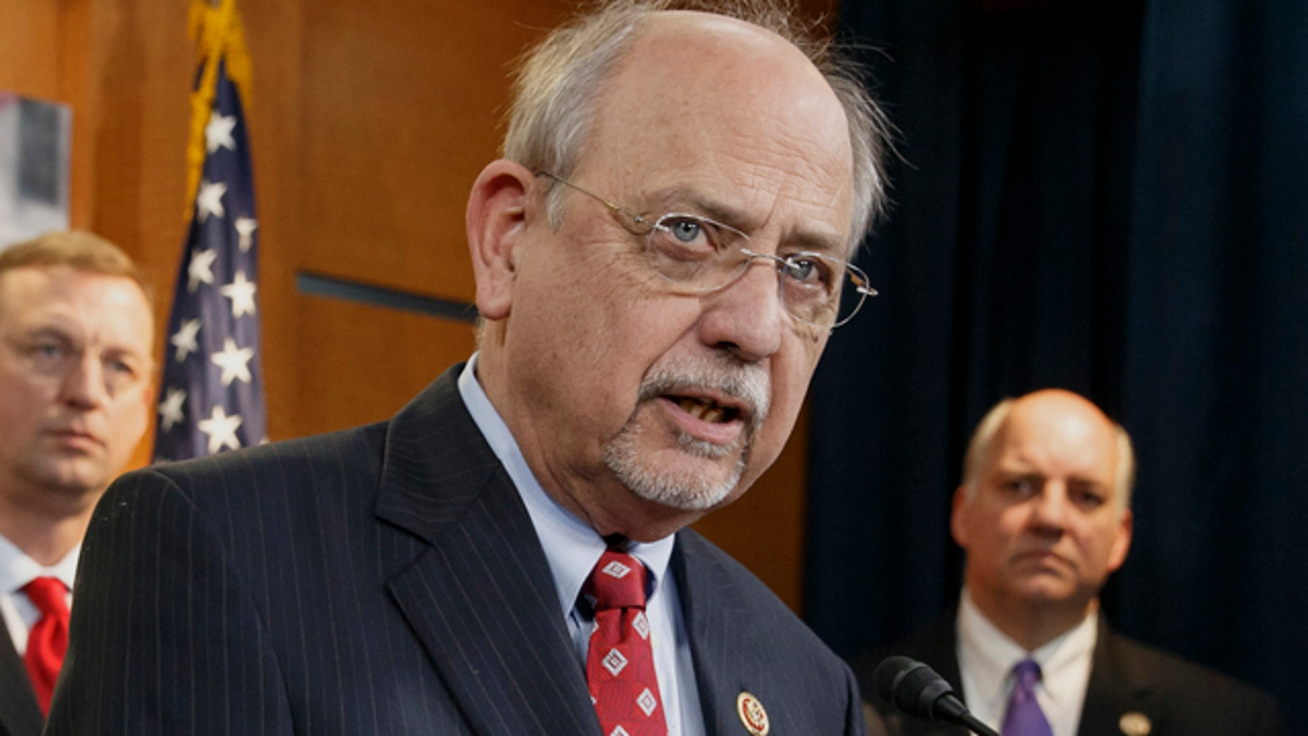 FILE - This Feb. 4, 2014 file photo shows Rep. Norman 'Doc' Hastings, R-Wash., during a news conference at the Capitol in Washington. (AP Photo/J. Scott Applewhite, file)