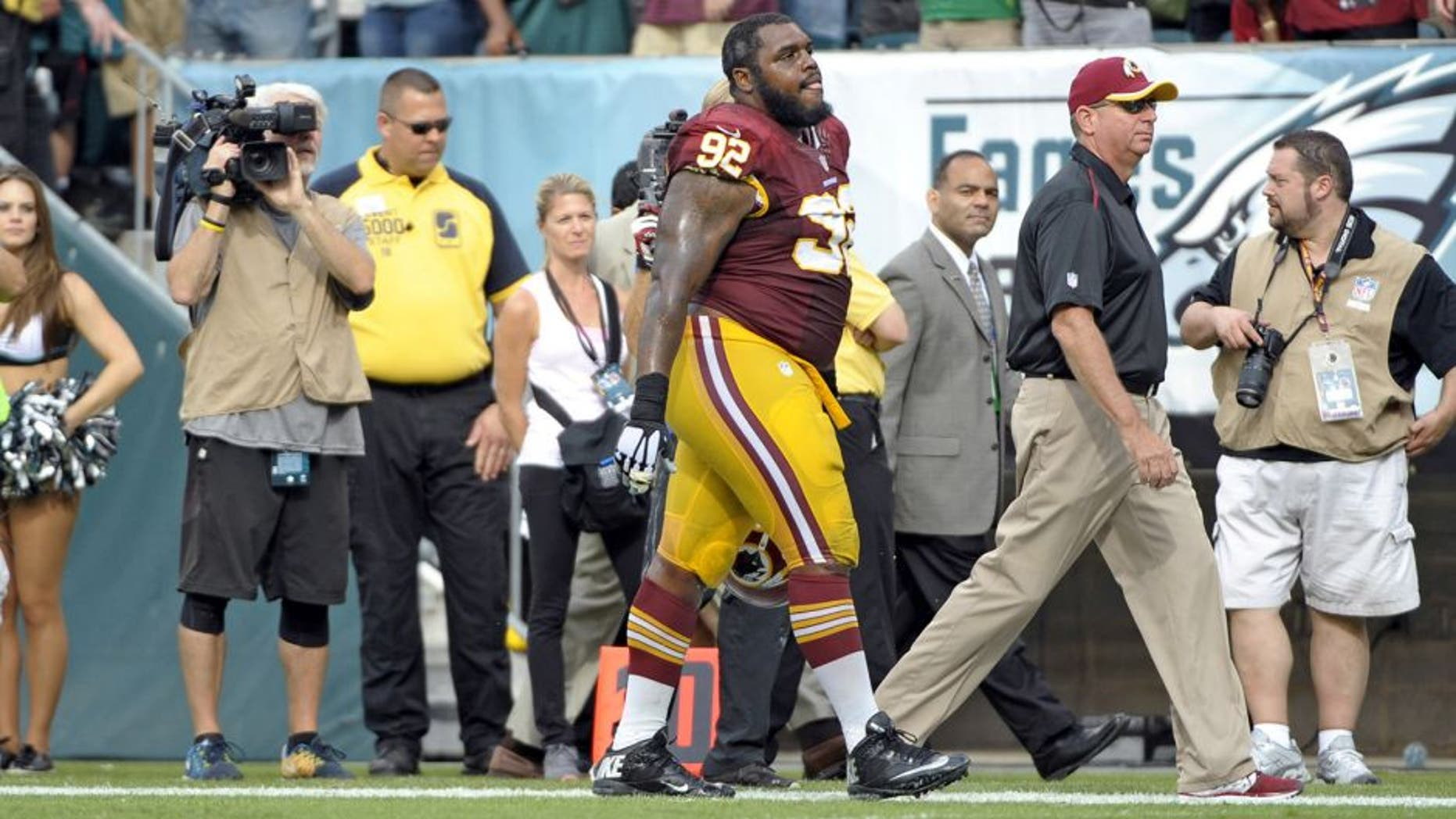 Sep 21, 2014; Philadelphia, PA, USA; Washington Redskins defensive end Chris Baker (92) walks off the field after being ejected during the fourth quarter against the Philadelphia Eagles at Lincoln Financial Field. The Eagles defeated the Redskins, 37-34. Mandatory Credit: Eric Hartline-USA TODAY Sports