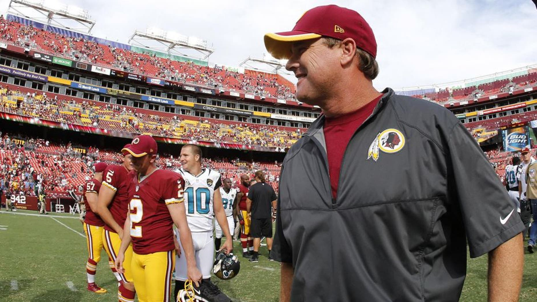 Sep 14, 2014; Landover, MD, USA; Washington Redskins head coach Jay Gruden (R) walks off the filed after the Redskins' game against the Jacksonville Jaguars at FedEx Field. The Redskins won 41-10. Mandatory Credit: Geoff Burke-USA TODAY Sports