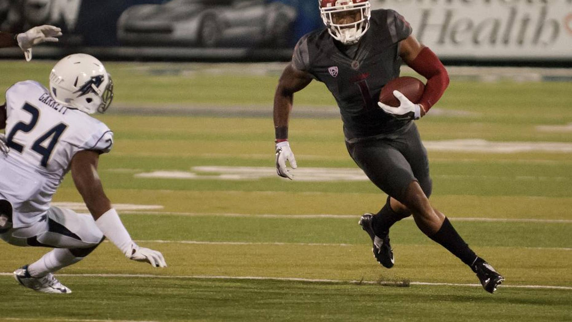 Washington State's Vince Mayle (1) turns the corner against Nevada's Charles Garrett (24) in the first half of an NCAA college football game on Friday, Sept. 5, 2014 in Reno, Nev. (AP Photo/Kevin Clifford)