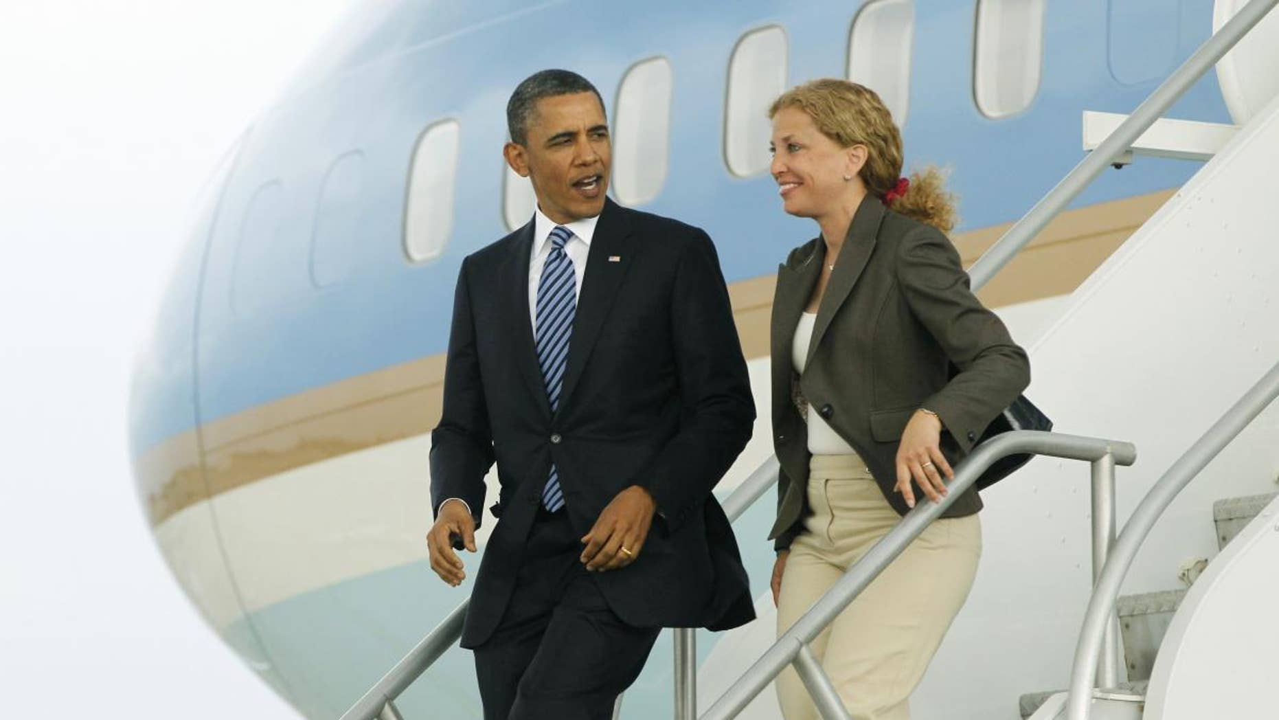 President Barack Obama and Democratic National Committee Chair, Rep. Debbie Wasserman Schultz, D-Fla. step off Air Force One in Miami, Friday, April 29, 2011. (AP Photo/Charles Dharapak)