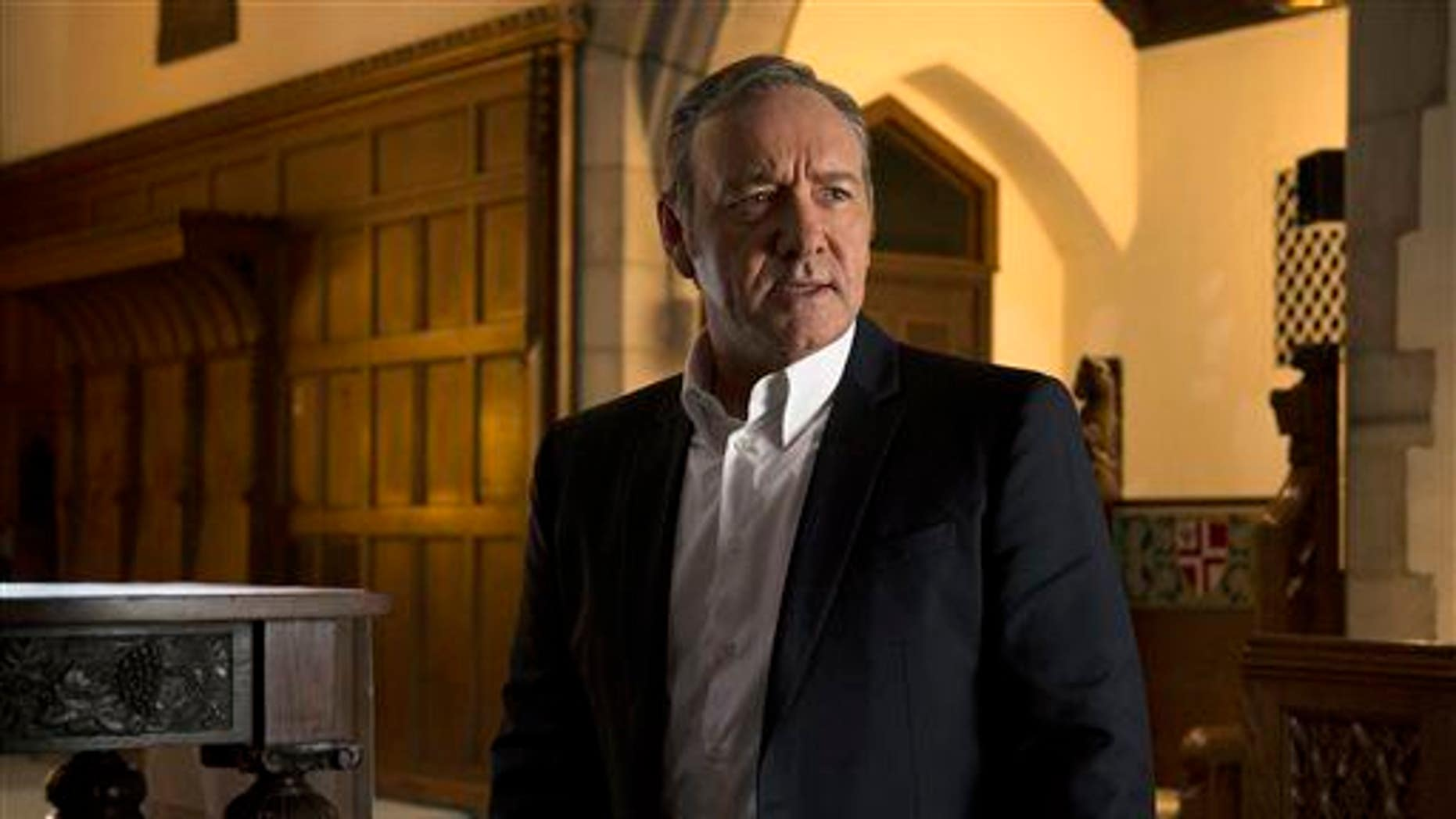 """In this image released by Netflix, Kevin Spacey appears in a scene from """"House of Cards."""" Binge watchers should be careful."""