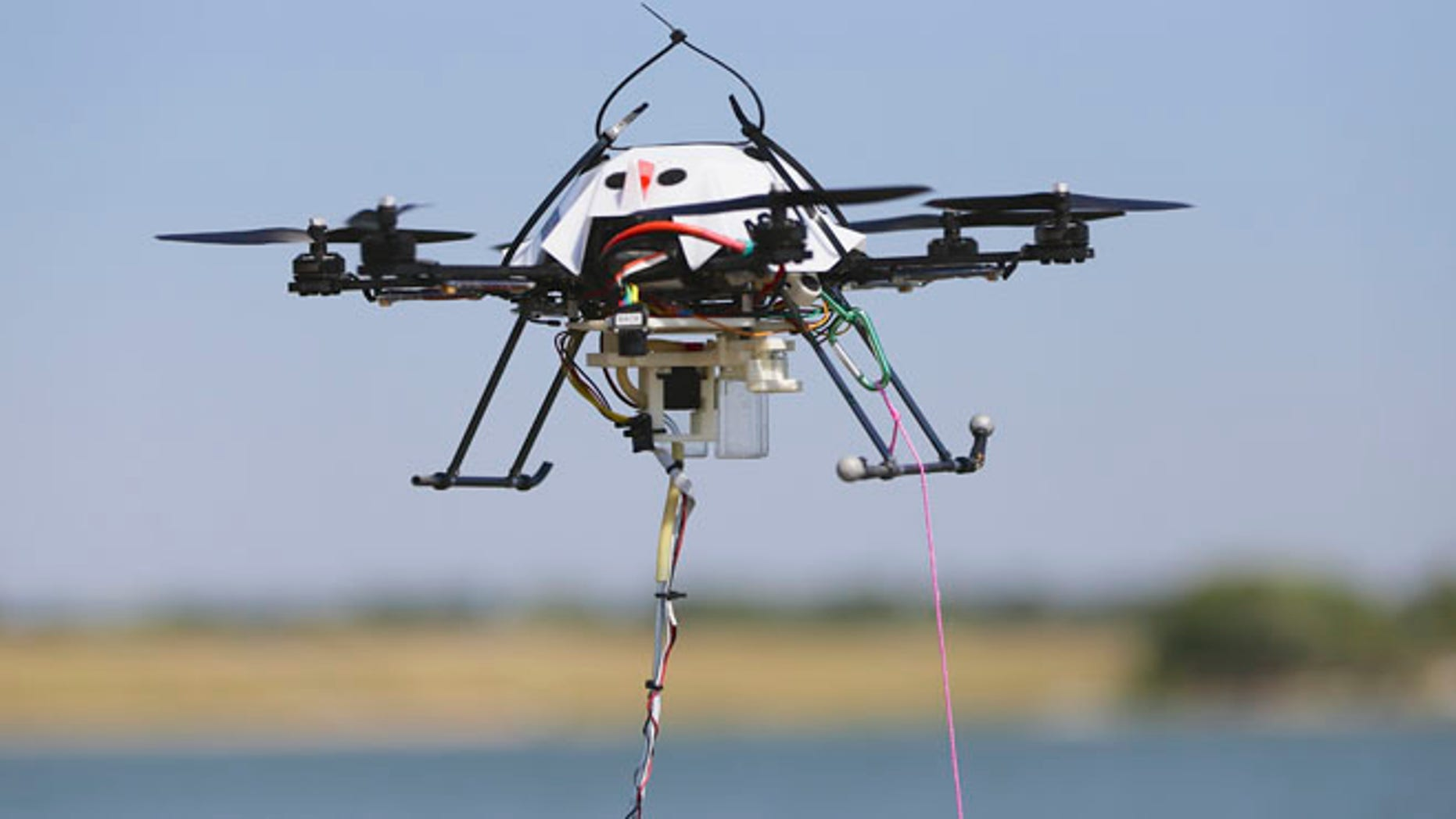 FILE: A water collecting drone hovers at a testing site in Lincoln, Neb.