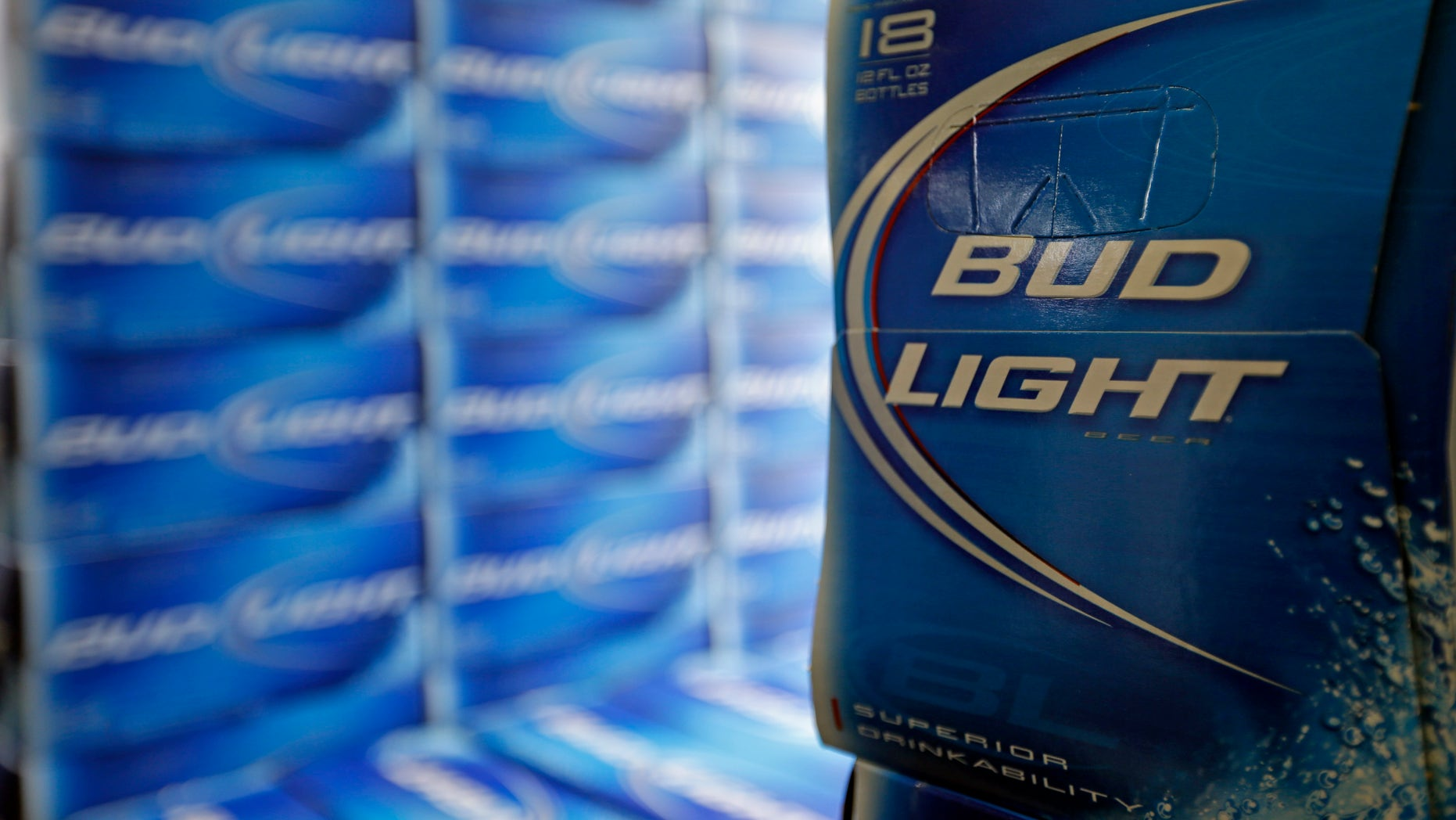 Jan. 28, 2013: File photo, Bud Light beer is shown in the aisles of Elite Beverages in Indianapolis. Beer lovers across the country have filed $5 million class-action lawsuits accusing Anheuser-Busch of watering down its Budweiser, Michelob and other brands.