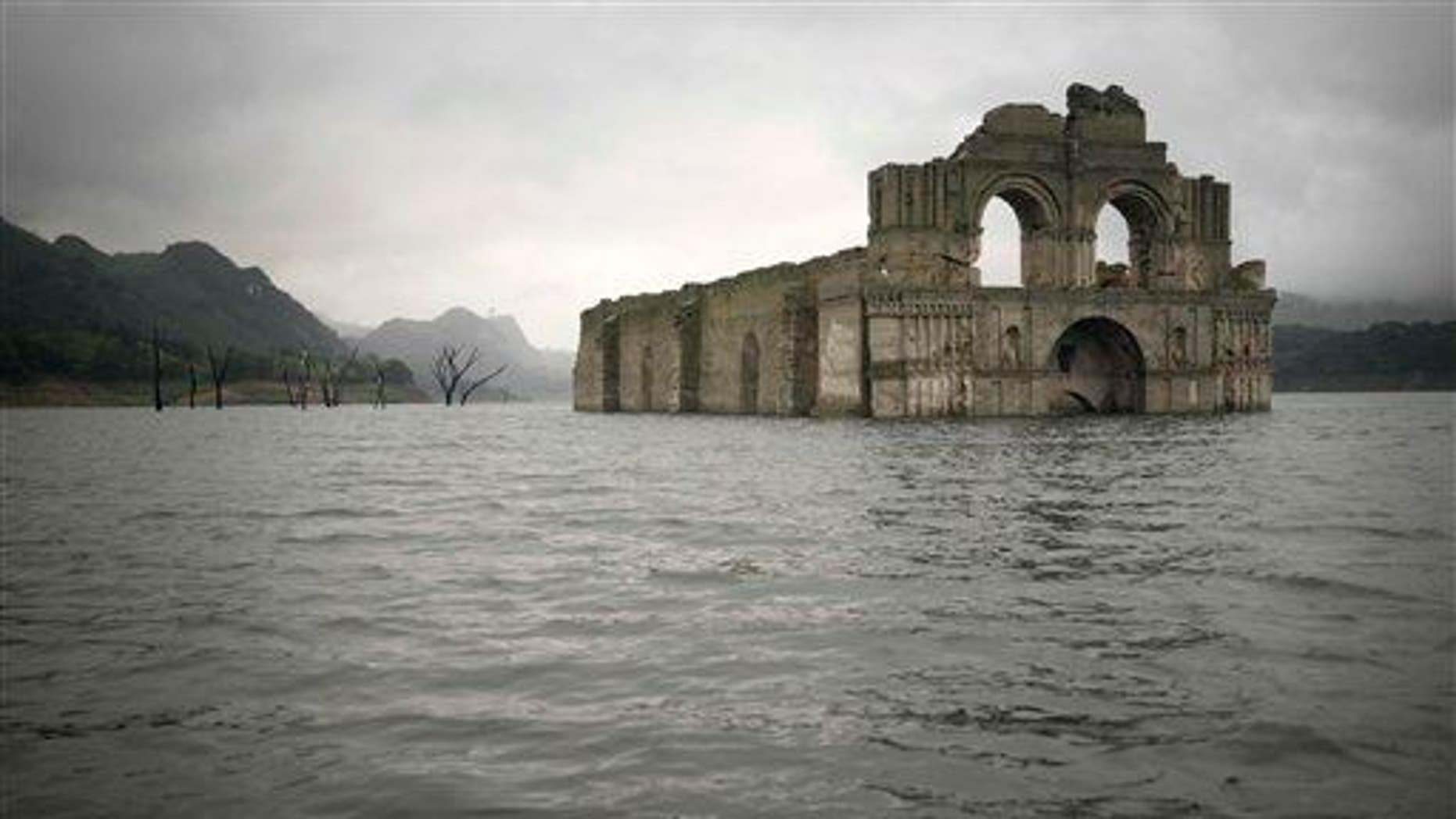 The remains of a mid-16th century church known as the Temple of Santiago is visible from the surface of the Grijalva River, near the town of Nueva Quechula, in Chiapas state, Mexico, Oct. 16, 2015.
