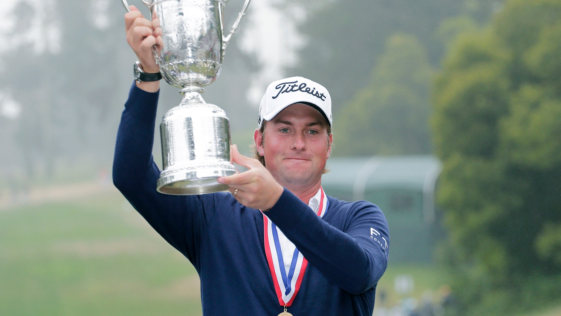 June 17, 2012: Webb Simpson holds up the championship trophy after the U.S. Open Championship golf tournament.
