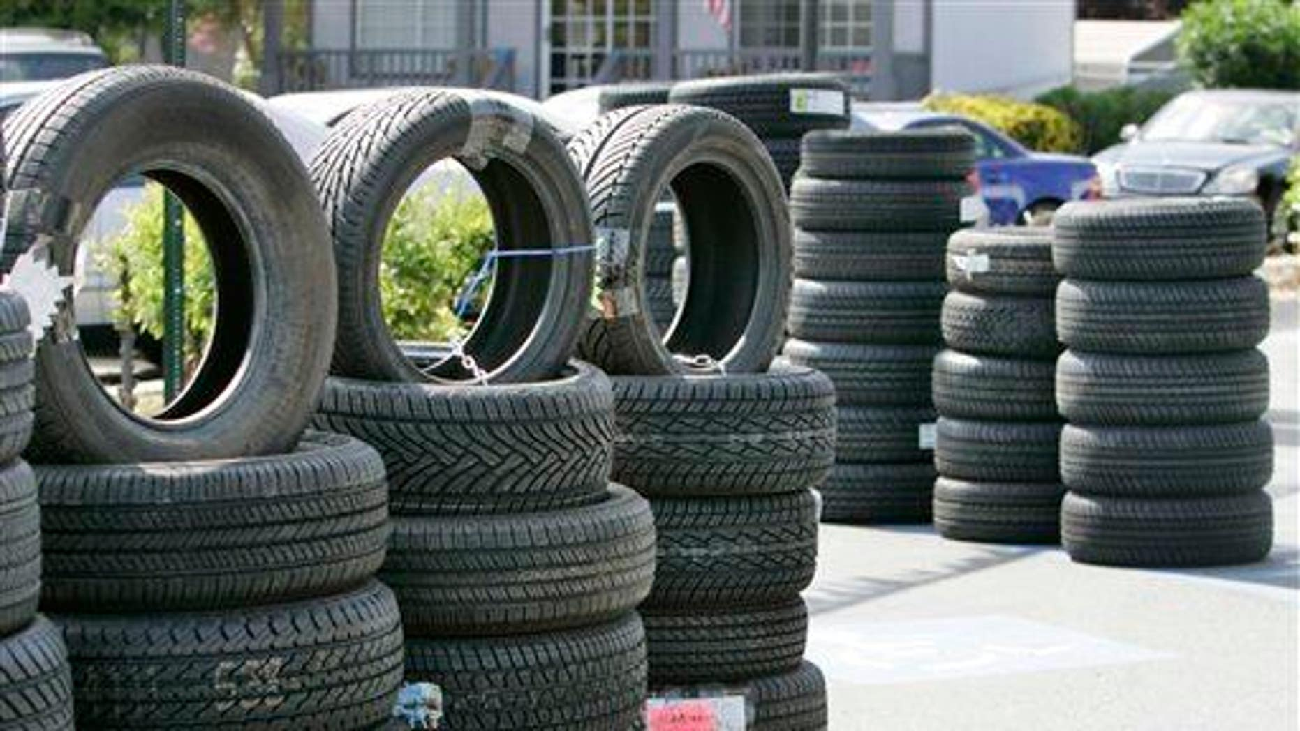 Tires are displayed outside of a Goodyear Tires shop in San Jose.