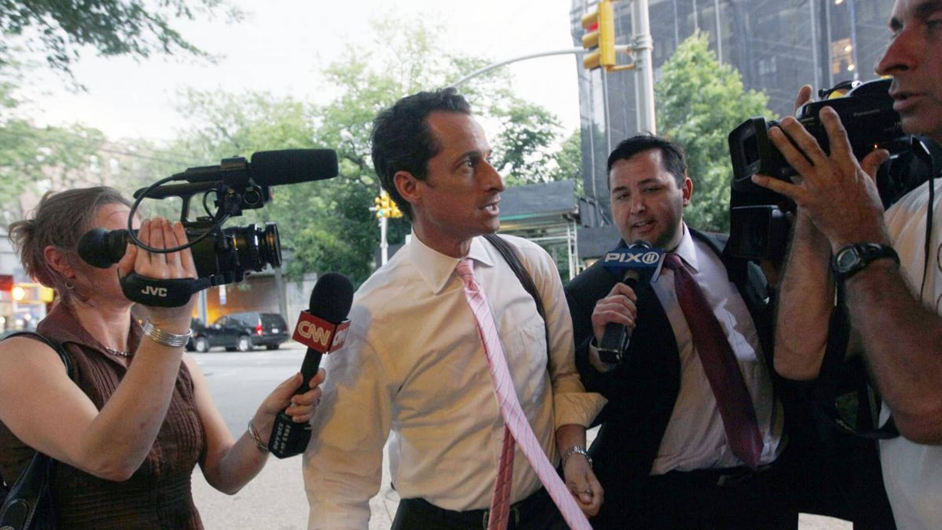 Rep. Anthony Weiner is surrounded by reporters as he arrives at his house in the Queens borough of New York June 9. (AP)