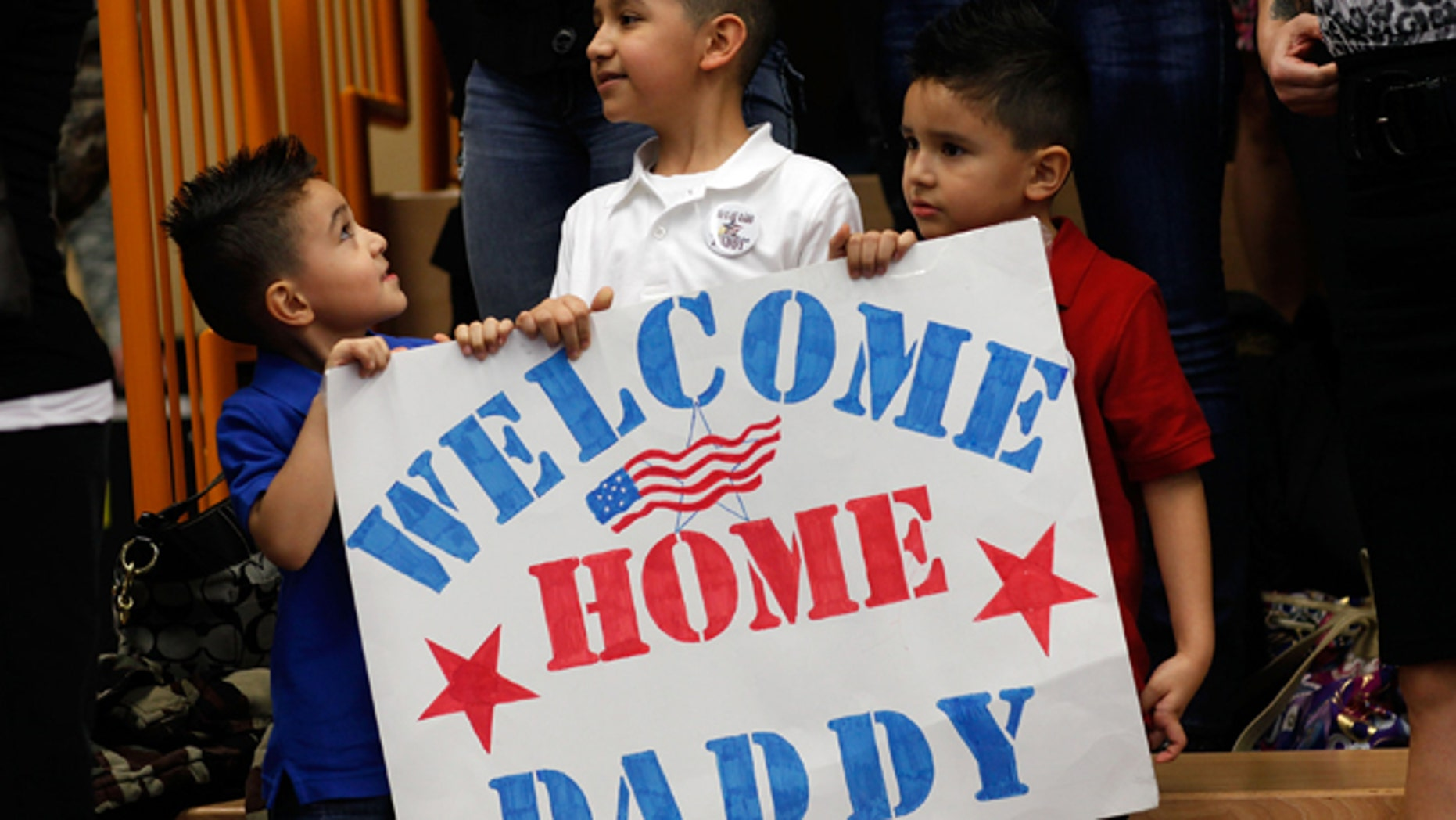 Family members wait for their loved ones of the 170th U.S. Army Infantry Brigade upon the troops' return from Afghanistan at U.S. Army Garrison Baumholder on January 28, 2012 in Baumholder, Germany. (Photo by Ralph Orlowski/Getty Images)